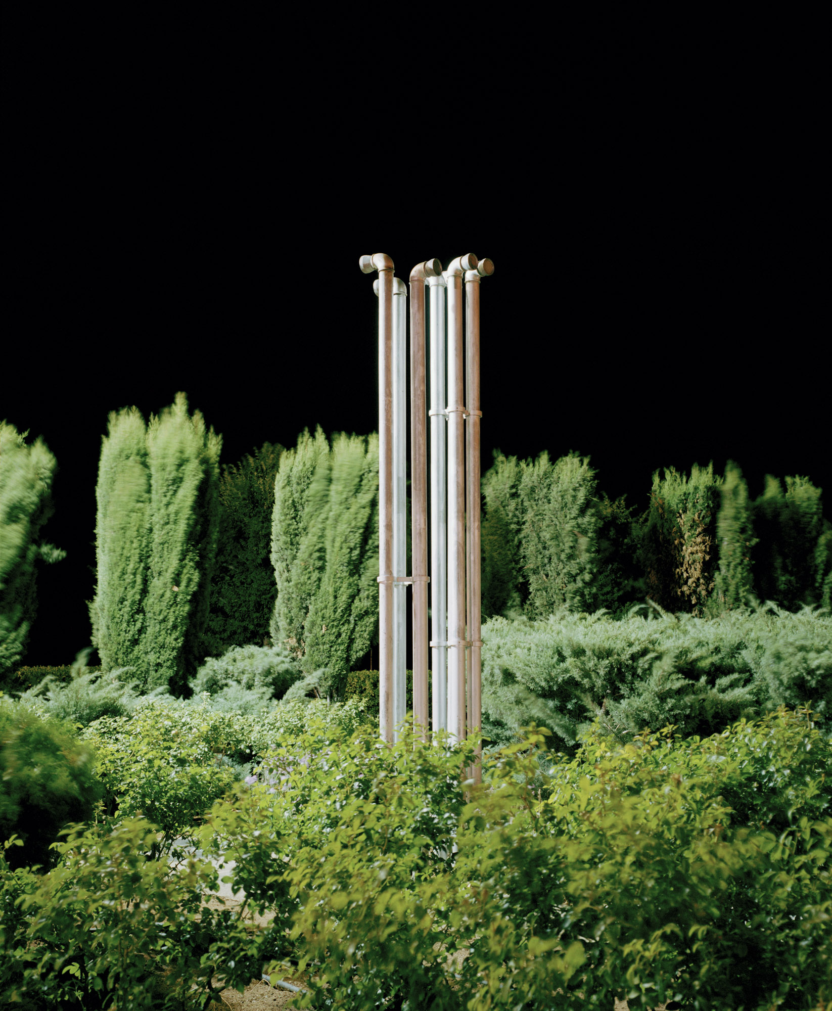 Have you ever noticed how cellphone towers in cities are disguised to look like trees while in the countryside they remain blatant red and white painted monoliths? Why is this?