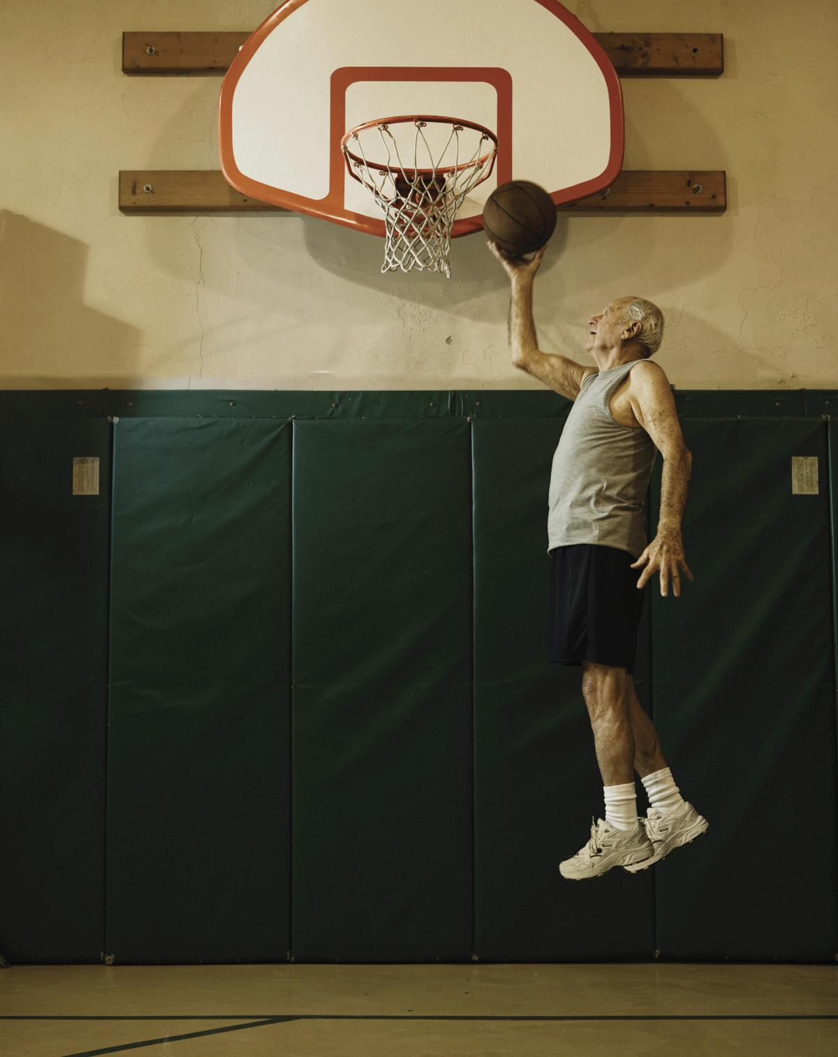 80 year old man playing basketball