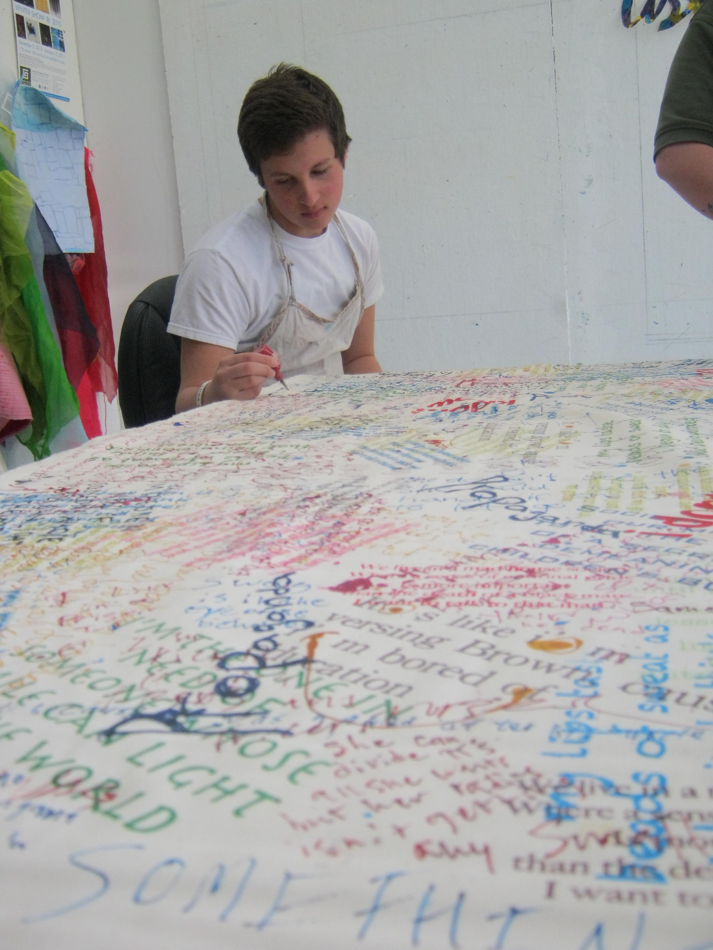 Daniel writing on cloth-day one.jpg