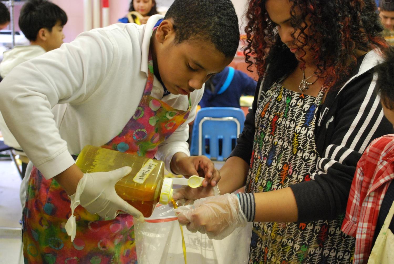 students dyeing cloth.JPG