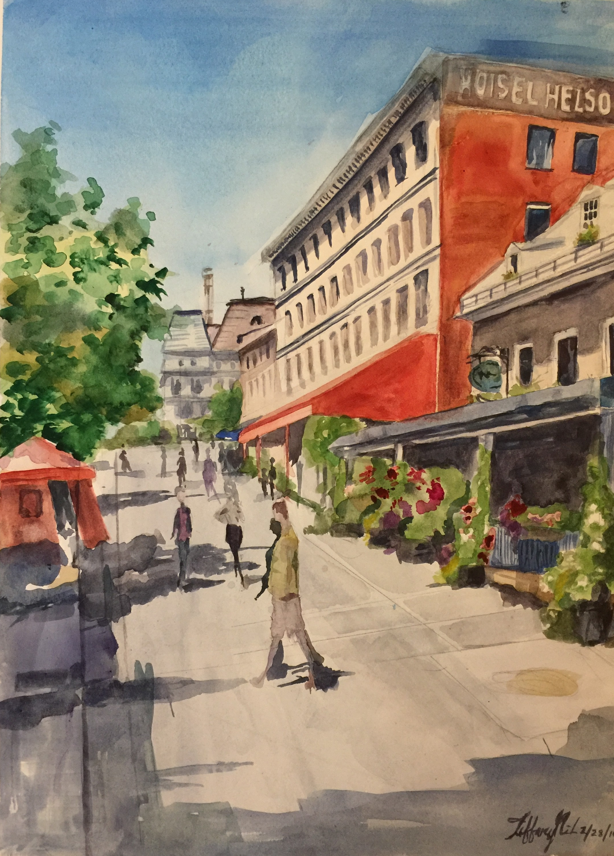 This watercolor painting portrays a lovely mid afternoon street scene in Montreal, Canada.The first building to the right is a flower shop andfurther down there is a little French hotel. To the left there is a little red tent and tree.