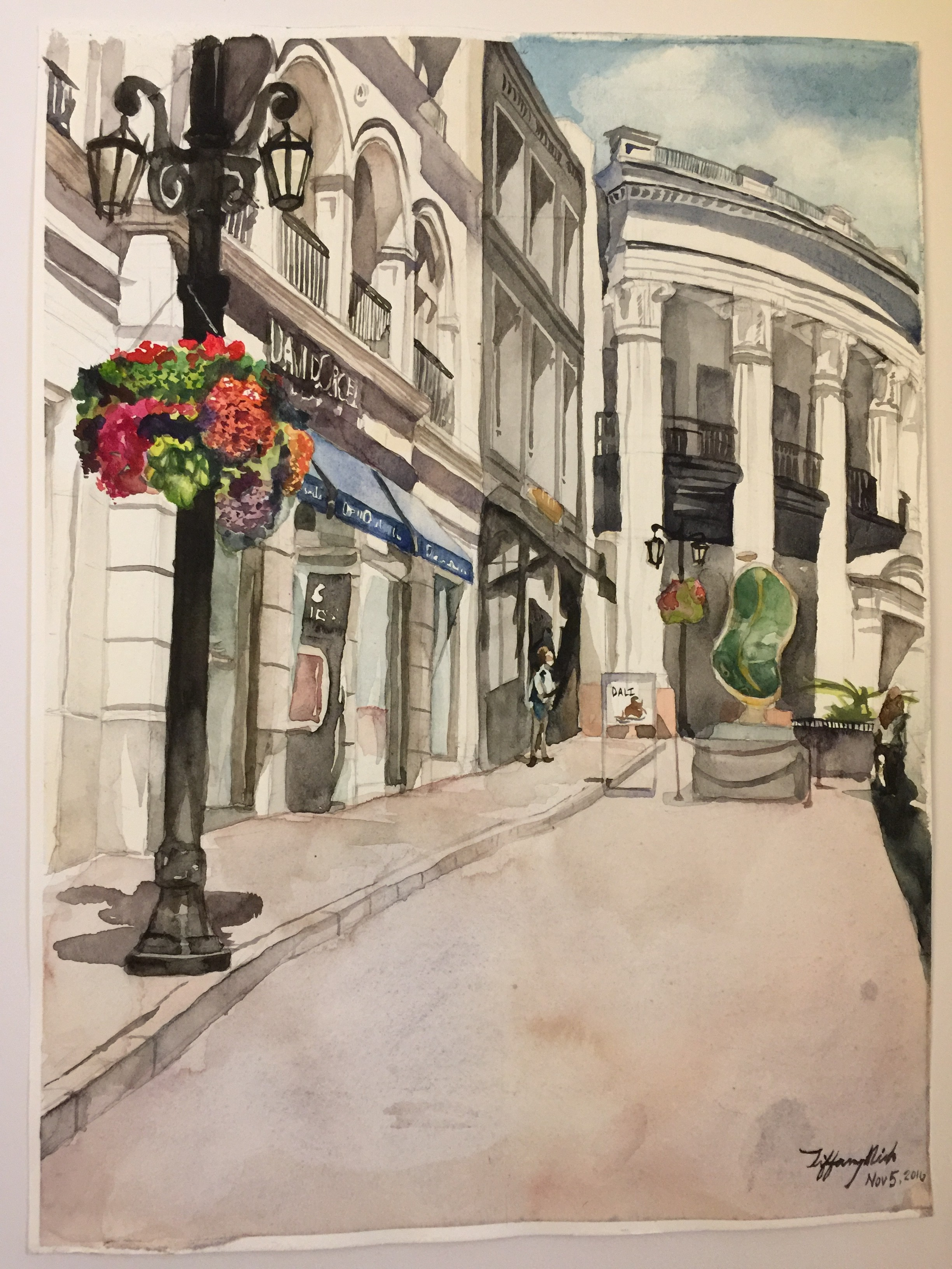 Watercolor painting of Rodeo drive in Beverly Hills, CA. In the back is the Porsche Design studio, and closer on the left is the David Orgell jewelry exhibit.