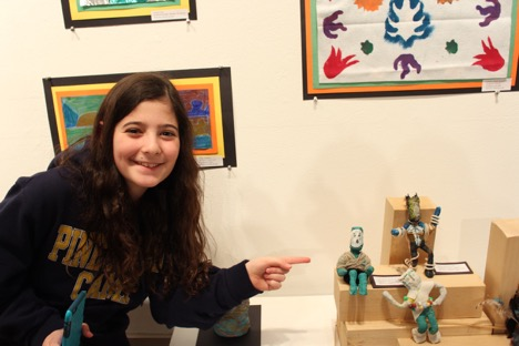 Elizabeth, a 5th grader, loves drawing and is looking forward to making art in middle school.