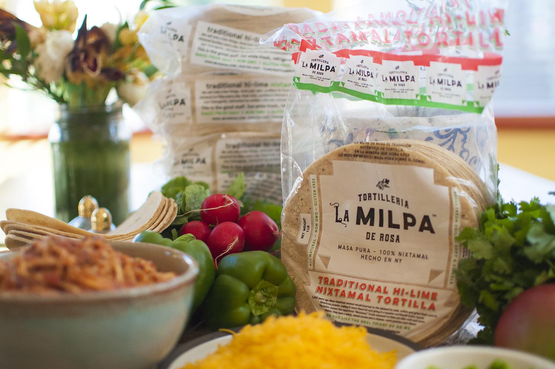 Authentic Mexican nixtamal, regular and blue masa, tortillas, and chips