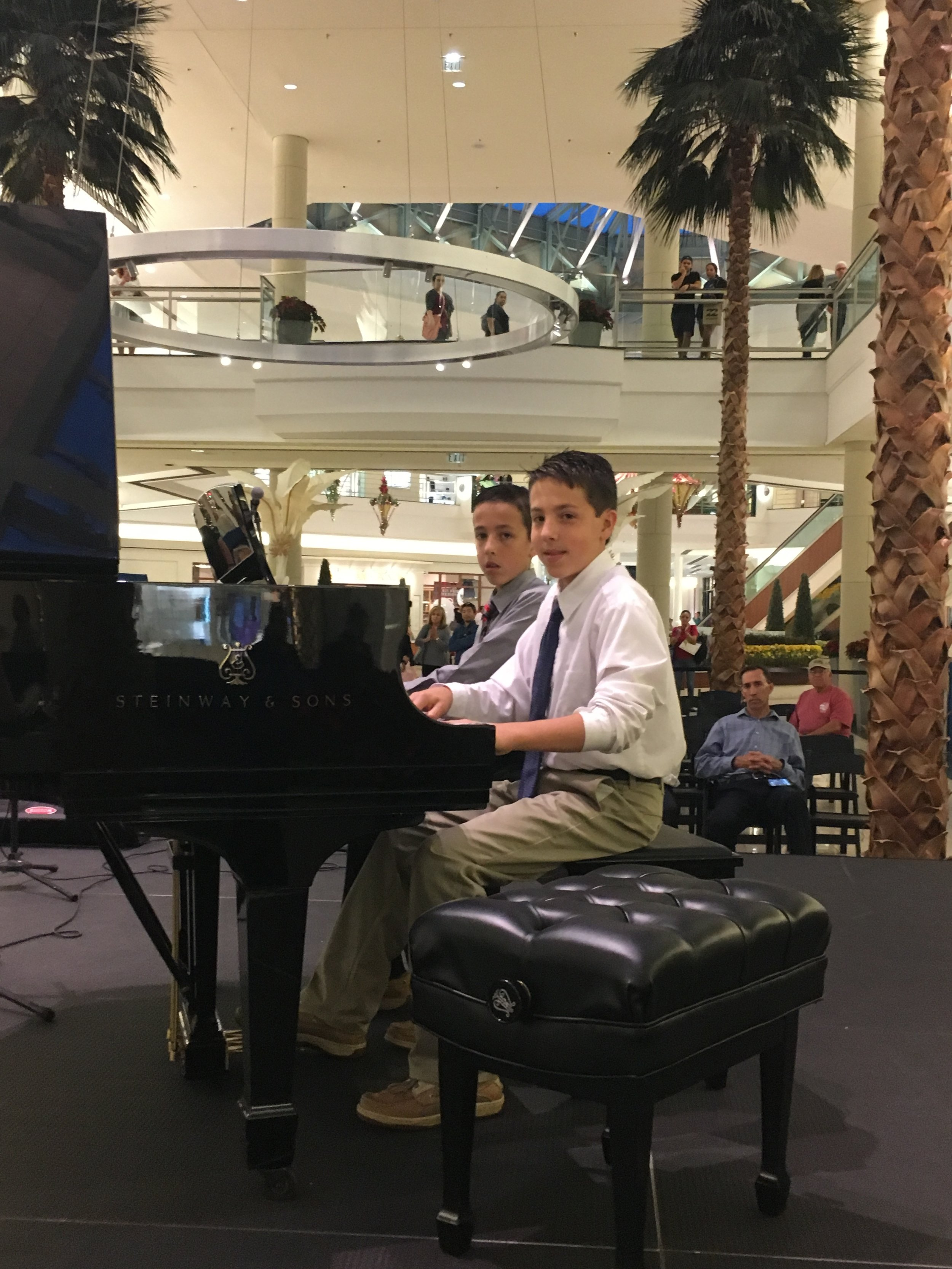 The Porter Brothers performing along with 20 other JAM students at the Gardens Mall.