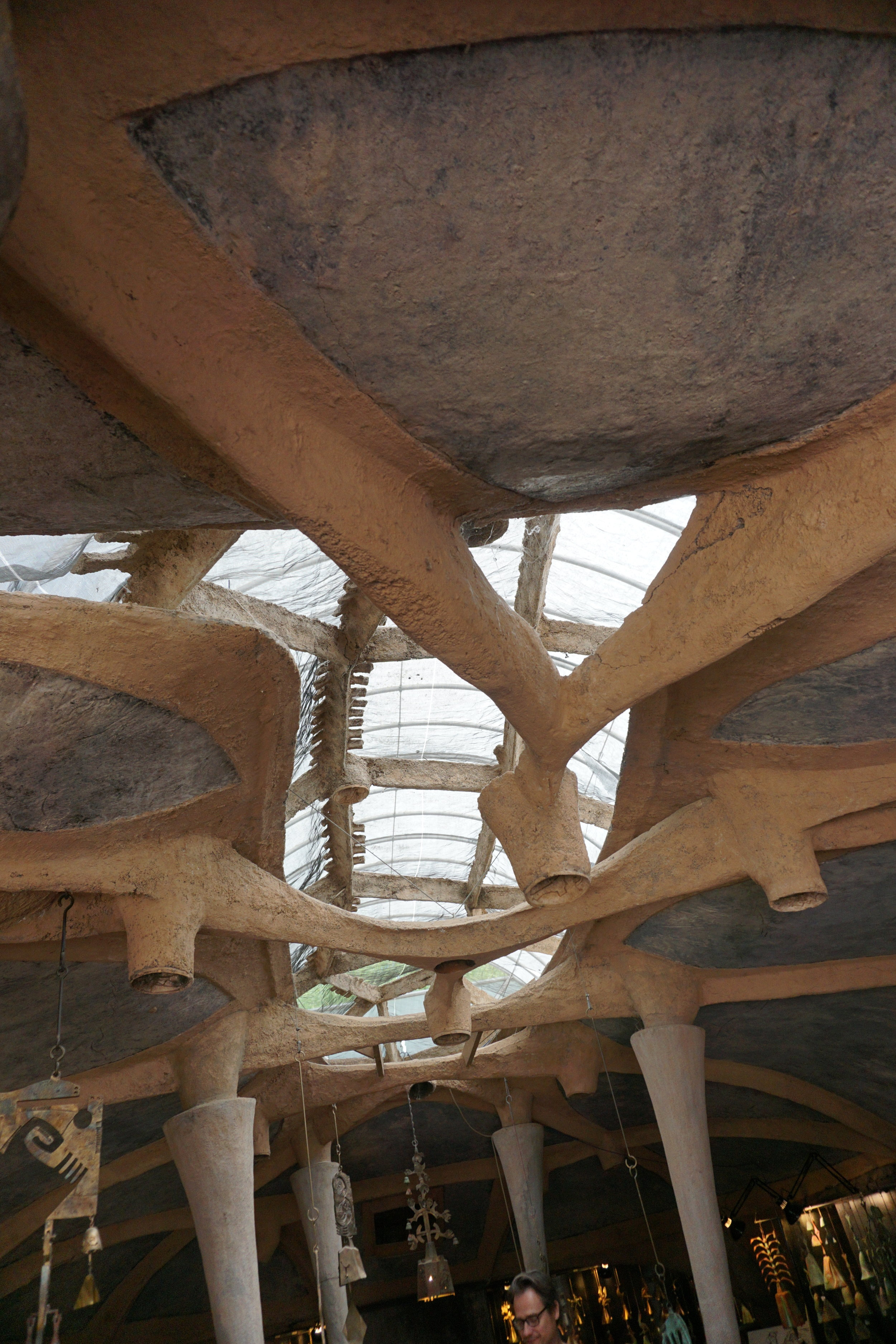 """This is the inside of the """"gift shop"""" at Cosanti.  Note the free flowing shapes of the structural elements."""