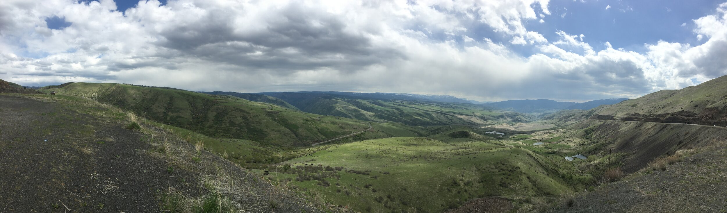 The ridgeline left of center is where the White Bird Grade is located.  This photo is taken from the new US-95 grade.  Even today some trucks still use the old road because of the steepness of the new road.