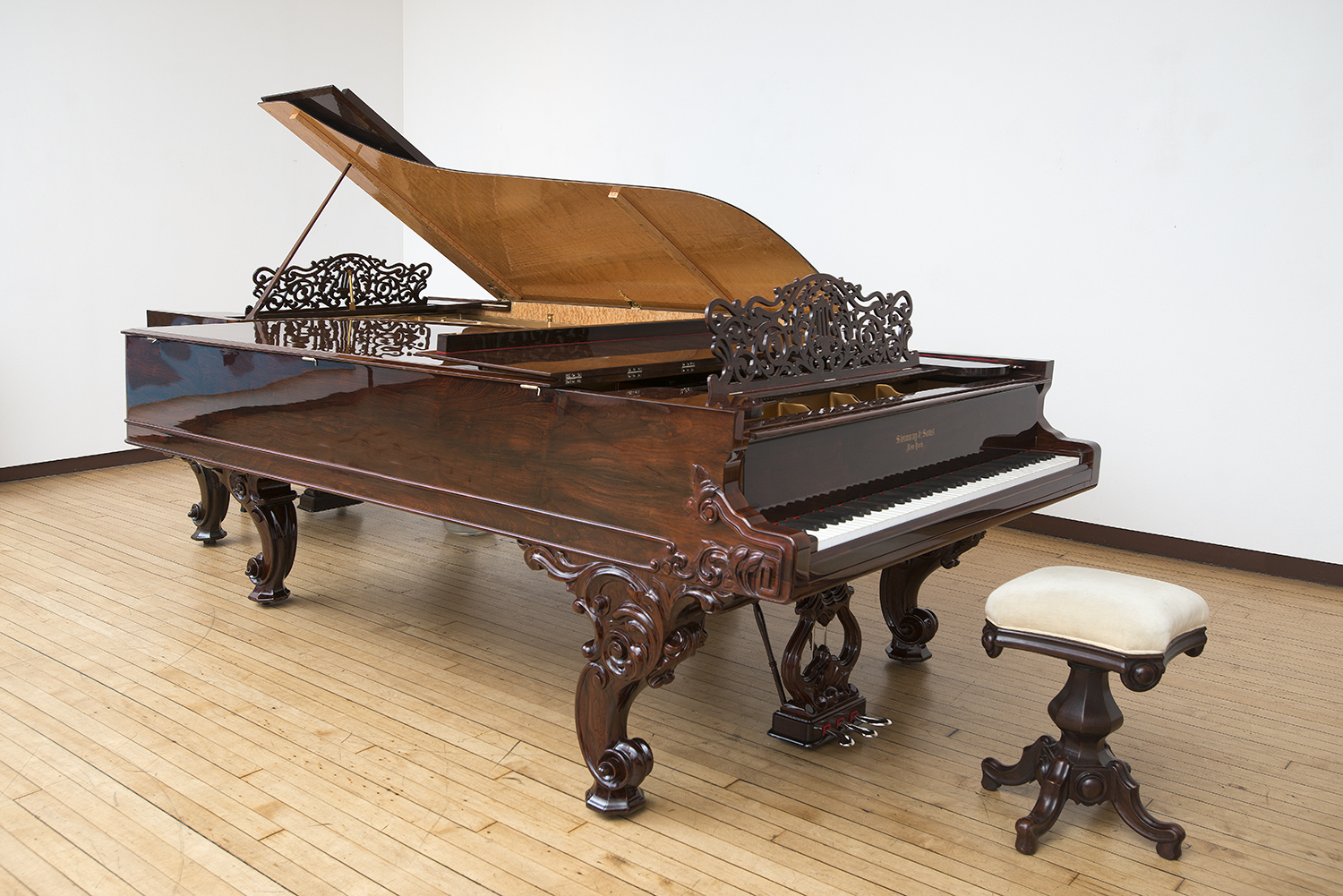 This Steinway Centennial Rosewood Concert Grand is owned by Louis K. Meisel and is located in the gallery for concert use.  This particular Steinway Centennial, serial number 34906, was built in March 1876 with the Steinway foundry casting date of March 5, 1876 on the plate and a workman's signature on the side of key 88 dated Marz '76. The instrument has an extra heavy plate and the extra third section capo d'astro bar made under C.F. Theodore Steinway's supervision early in 1876. It became known as the Centennial after being exhibited at the Centennial Exposition in Philadelphia and winning the gold medal.  This instrument comes with the original purchase document and was acquired by the present owner from the great-grandson of the original owner. The instrument has the original ebony sharps and flawless, very thick (1/16 inch) one piece ivories. The original action is meticulously restored with 20 pound hammers, made by Norbert Abel. The Centennial is the first fully modern piano with string tensions greater than the current mass-produced Concert Grand that initially went into production after 1877. Its fundamental sustainability and power, through all registers, is unsurpassed.  In his authoritative book, Pianos and Their Makers, Alfred Dolge discusses the Steinway Centennial Rosewood Concert Grand. He points out how Theodore Steinway through his friendship with Helmholtz and other scientists was inspired by their research to make the breakthrough design which lead to this innovative piano.