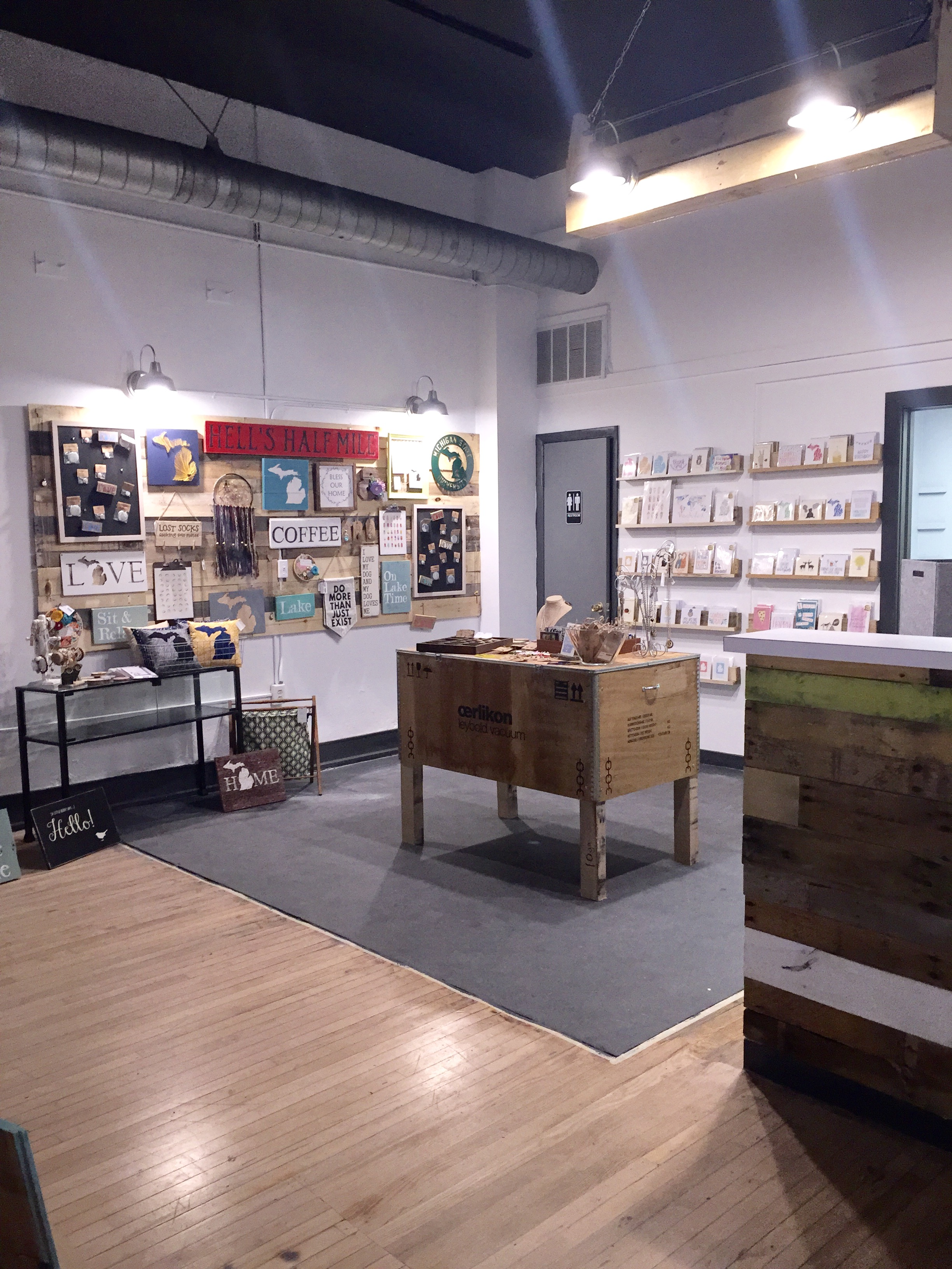 The back corner of the store all complete! Some of the notable things: the cash wrap covered in pallet wood, the perfect card wall, and the table in the center of the photo.