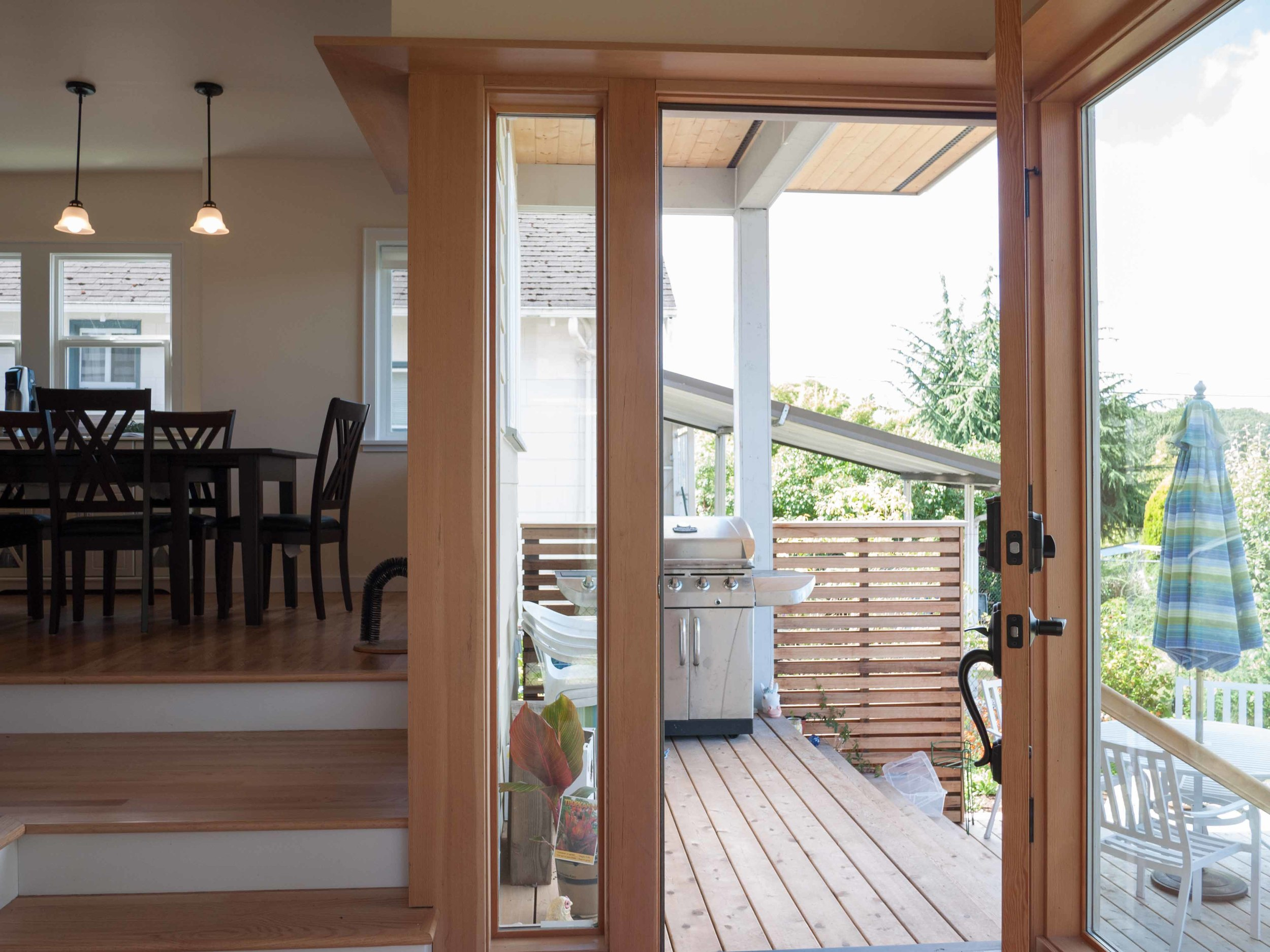 The mudroom opens to the outdoor deck. The ledge above the windows and doors provides a catwalk for our clients' cats.
