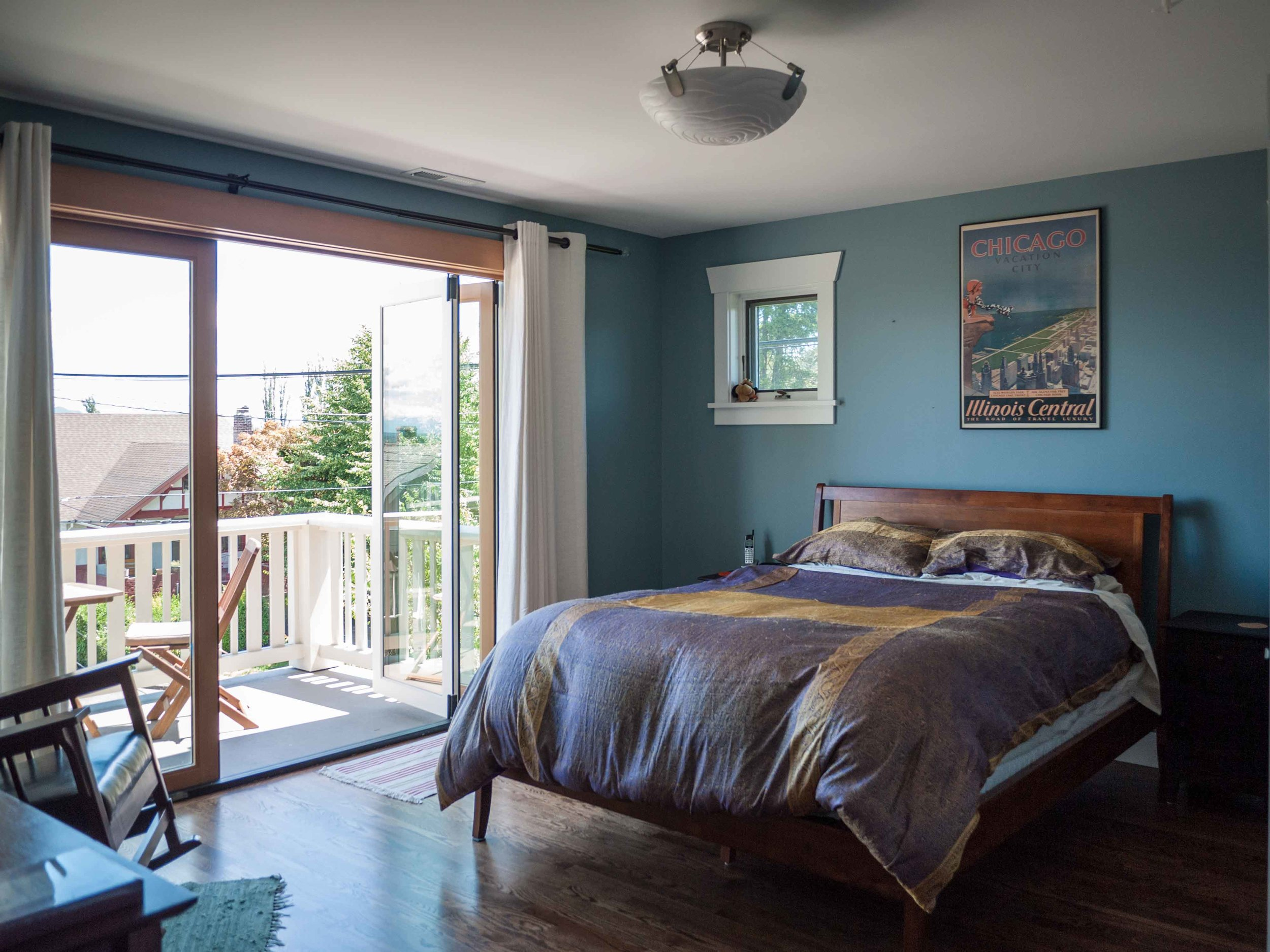 The master suite's folding wall of windows allows our clients to connect with the outdoors and enjoy views of the Cascades.