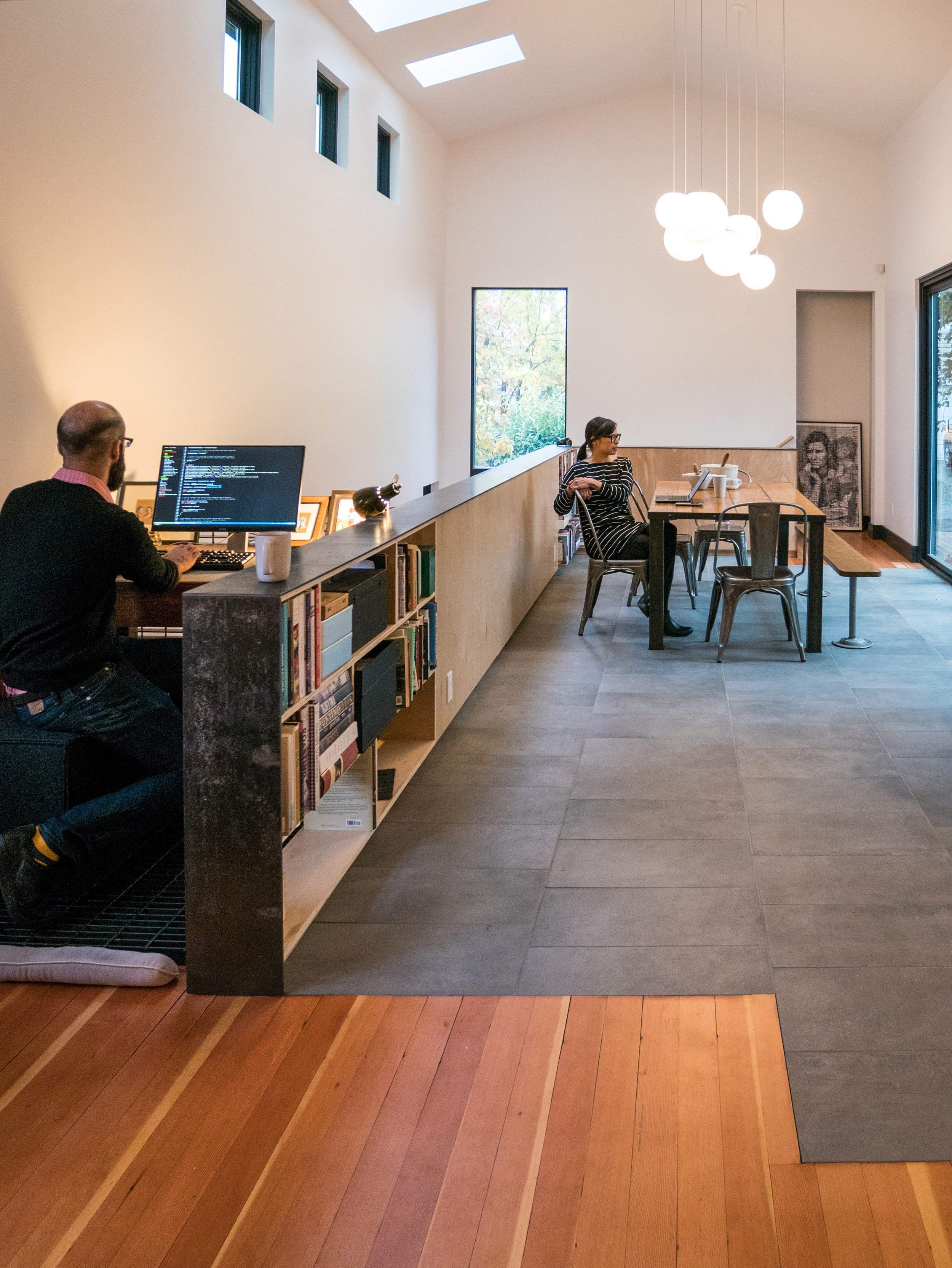 Our clients sometimes work from home. A dedicated work space works best for one, while the other can work from a variety of locations in the house.