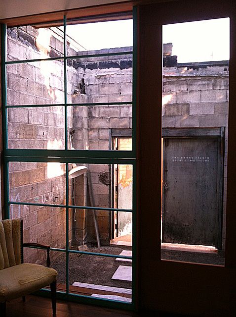 A view of the courtyard and the boiler room ruins.