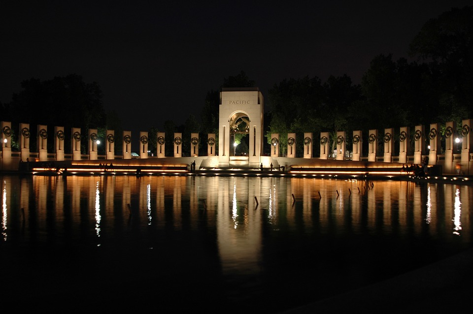 world war ii Veterans memorial at night featured on the about page for the law office of amy b. kretkowski