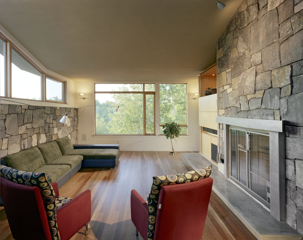with a ceiling bent to southern light and a northern view of the valley, the living room is solid and warm