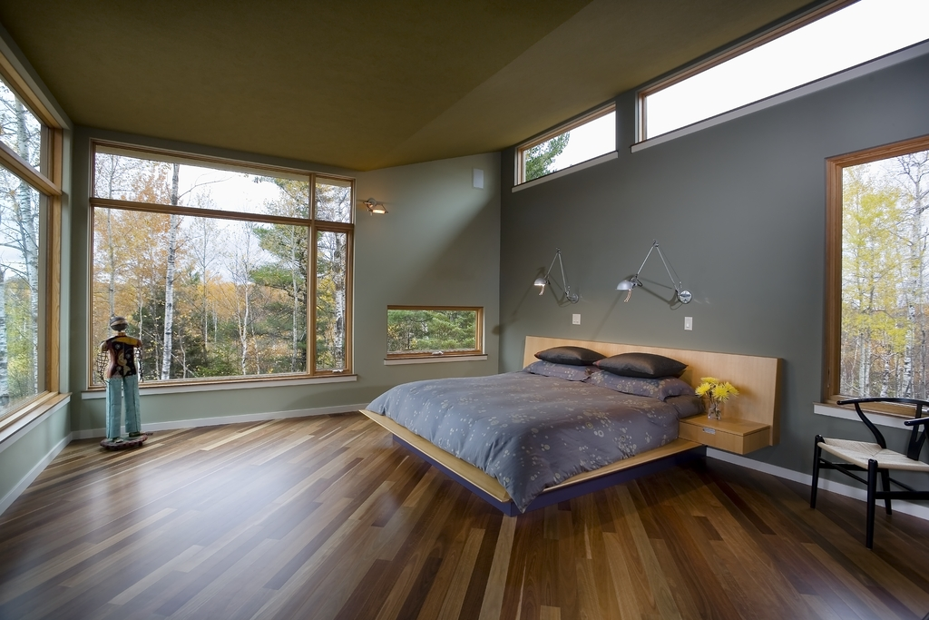 ceiling bends to the eastern light and a place is made for the bed and the simple view as one turns to the side