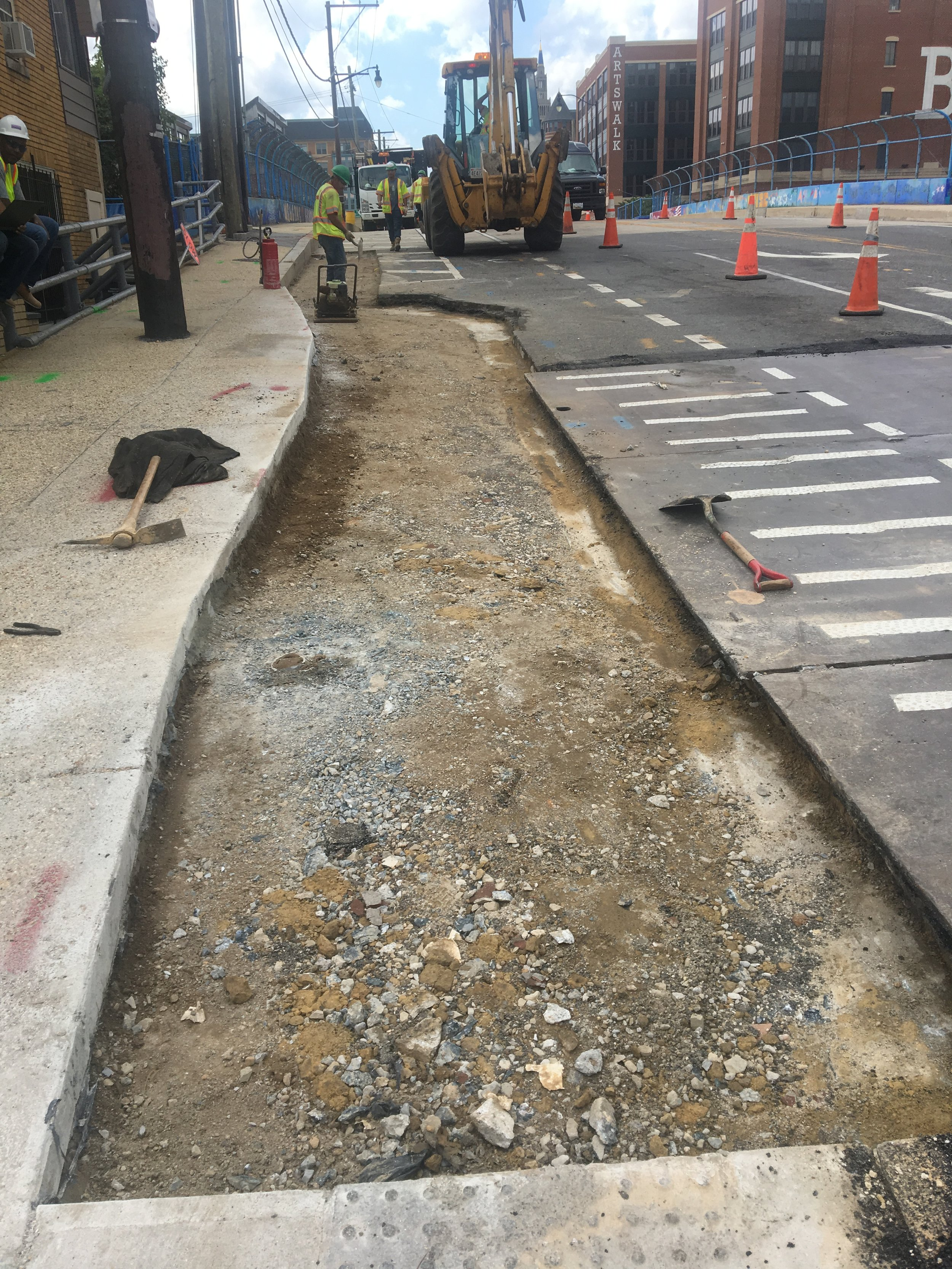 Bump out cut and temporary pavement at the intersection of Monroe and 9th
