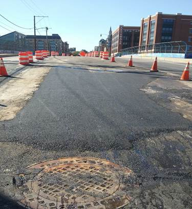 Temporary asphalt over trench at 9th & Monroe