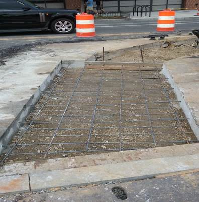 Reinforcing for utility cuts repair at 8th & Monroe