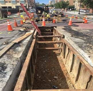 Trench excavation for 12-way conduits – 8th & Monroe