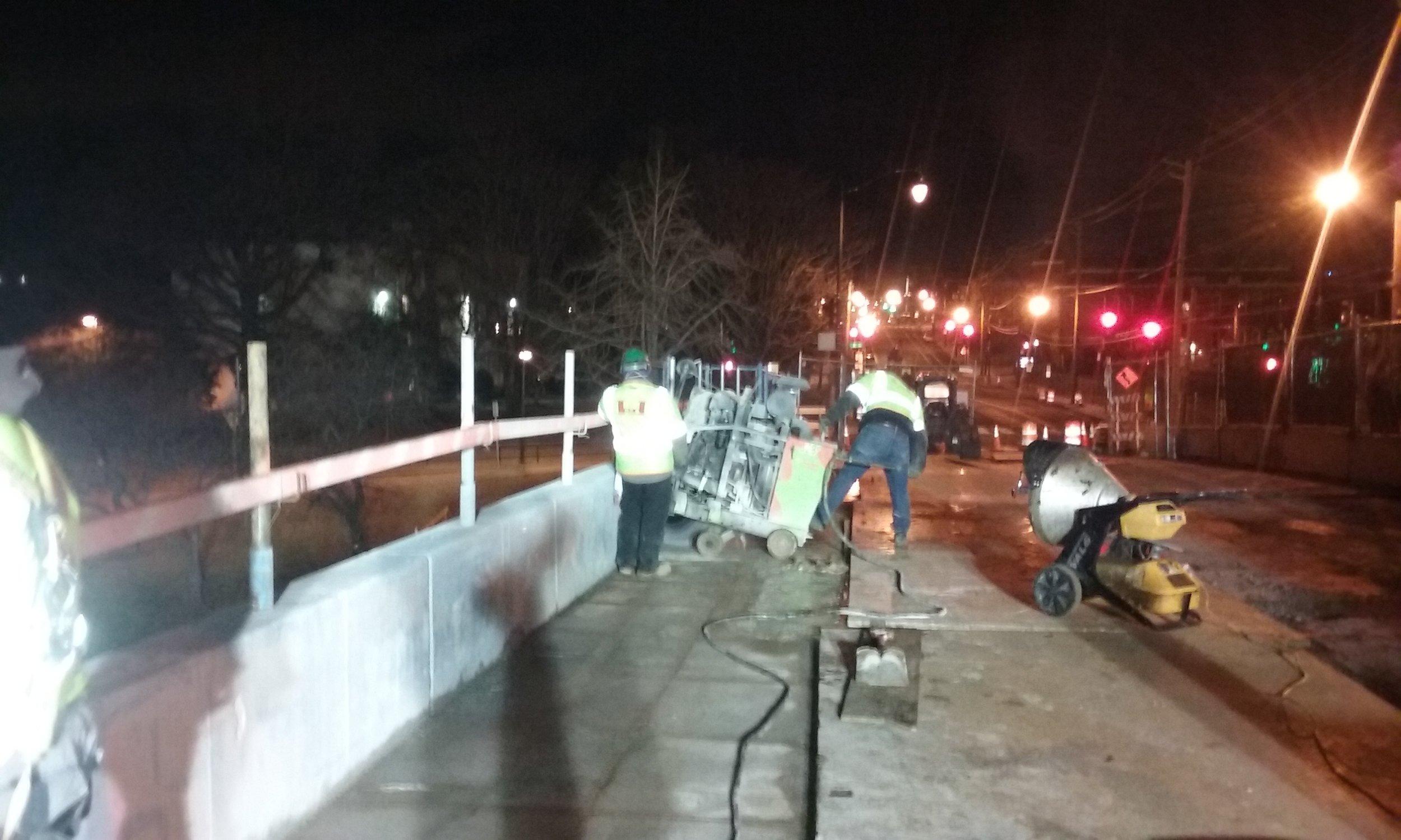 Parapet saw cutting over the bridge