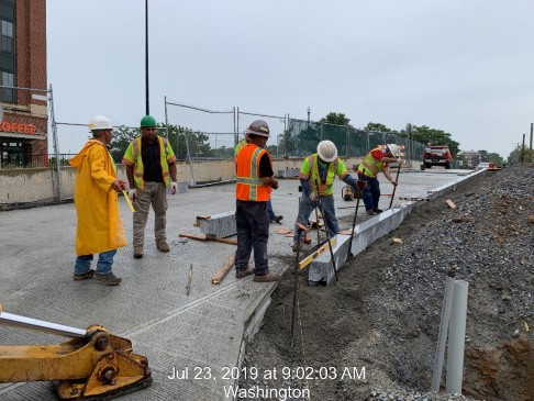 Granite Curb installation between 8th St and West approach slab, Phase 2