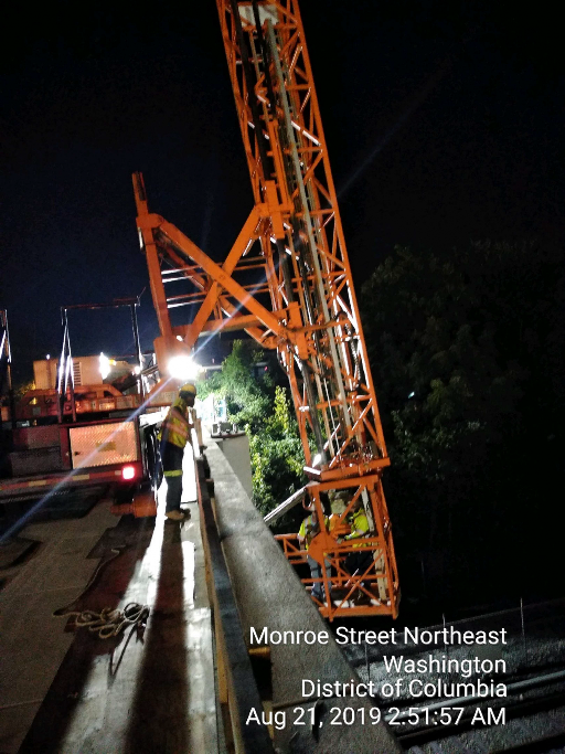 Snooper truck on south side under span 2, deck from removal, Phase 2