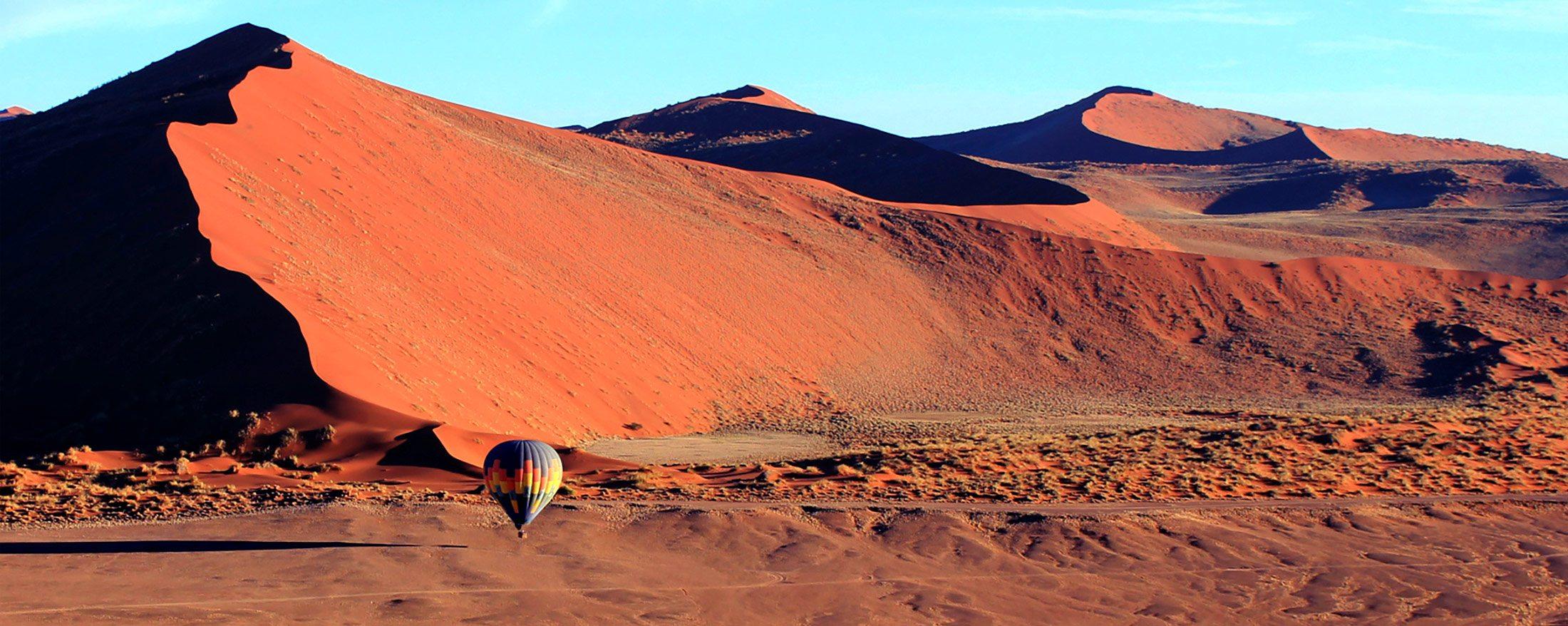 BANNER-Namibia_Sossusvlei_NamibSkyBalloonSafaris_BalloonInDunes2.jpg