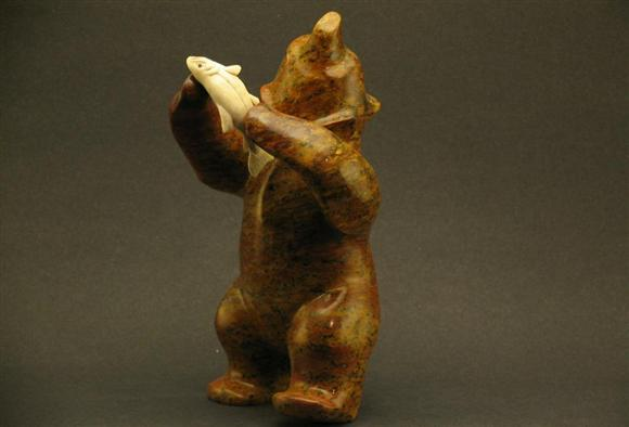 BEAR DANCING WITH FISH