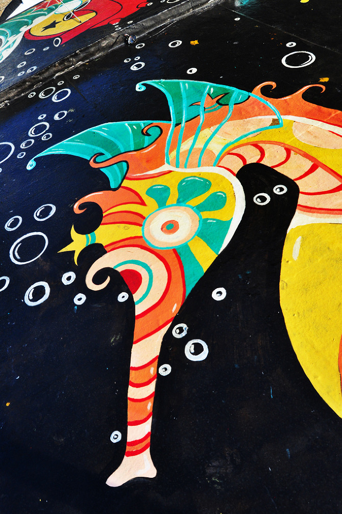 Detail of Seahorse mural by Maxine Nienow    In 2012, Maxine co-created  FlutuArte , a public art installation where 45 international artists joined to paint murals on the rooftops of 60 fishing boats in a historic harbor in Rio de Janeiro, Brazil. FlutuArte brought not only new vibrant colors to this fishing community, but also a new economy of tourism.
