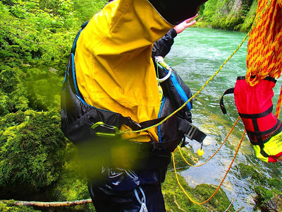 Notice how the open-gate carabiner has forced its way through the pocket of this PFD!