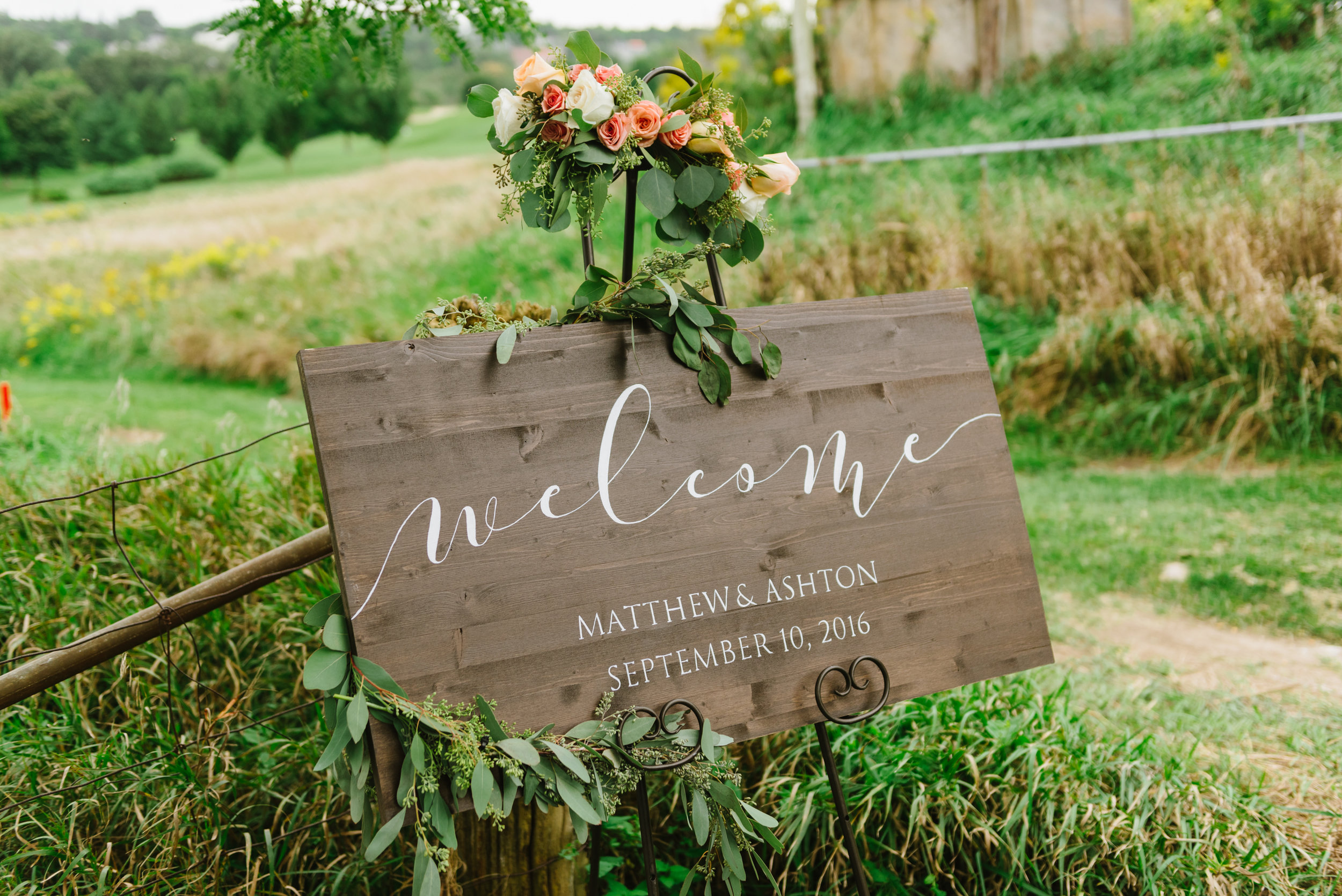 Wooden sign crafted by bride    Ashton Staffen   , for her rustic fall wedding in St. Marys.   Venue:    St. Marys Golf & Country Club   . Photography:    Erin Leydon   .
