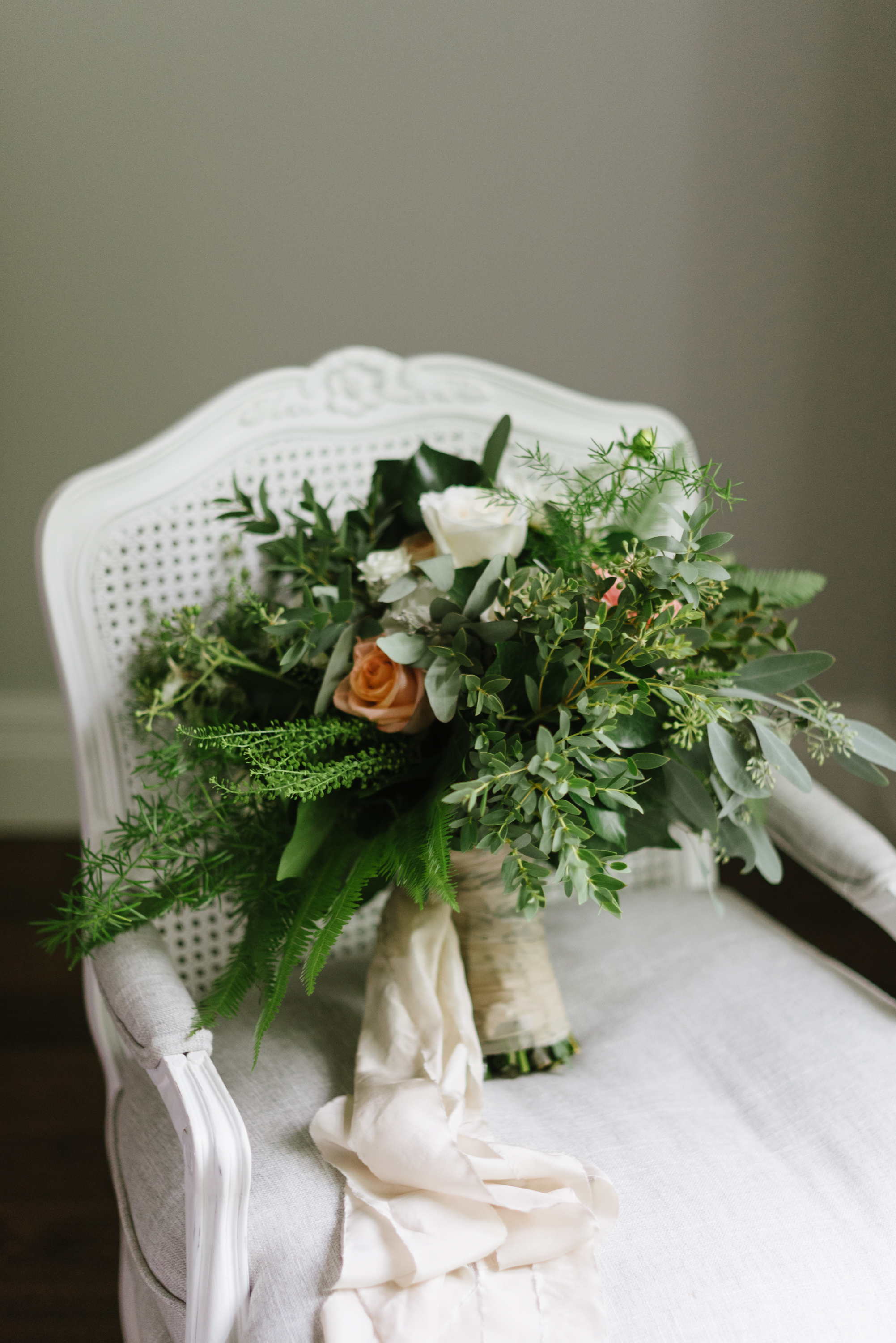 An oversized, loosely-arranged, garden-inspired bouquet by    Lyric Flowers   , for St. Marys bride    Ashton Staffen   .   Photography:    Erin Leydon   .