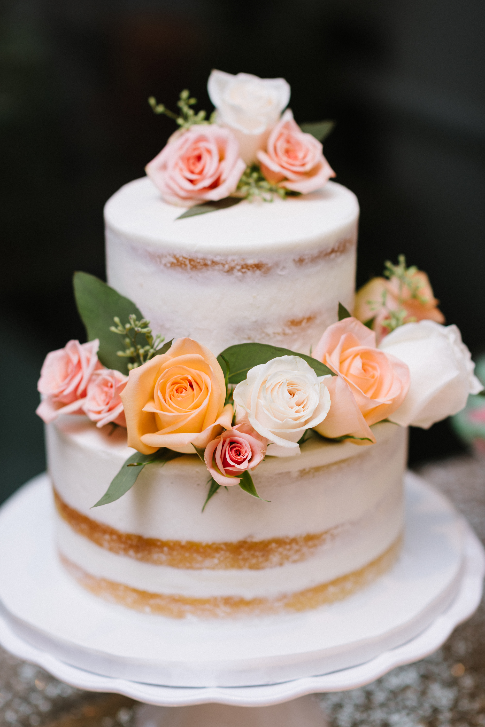 Vanilla naked cakes, dressed in floral and greenery, are the ultimate rustic-themed wedding choice. Venue:    St. Marys Golf & Country Club   . Photography:    Erin Leydon   .