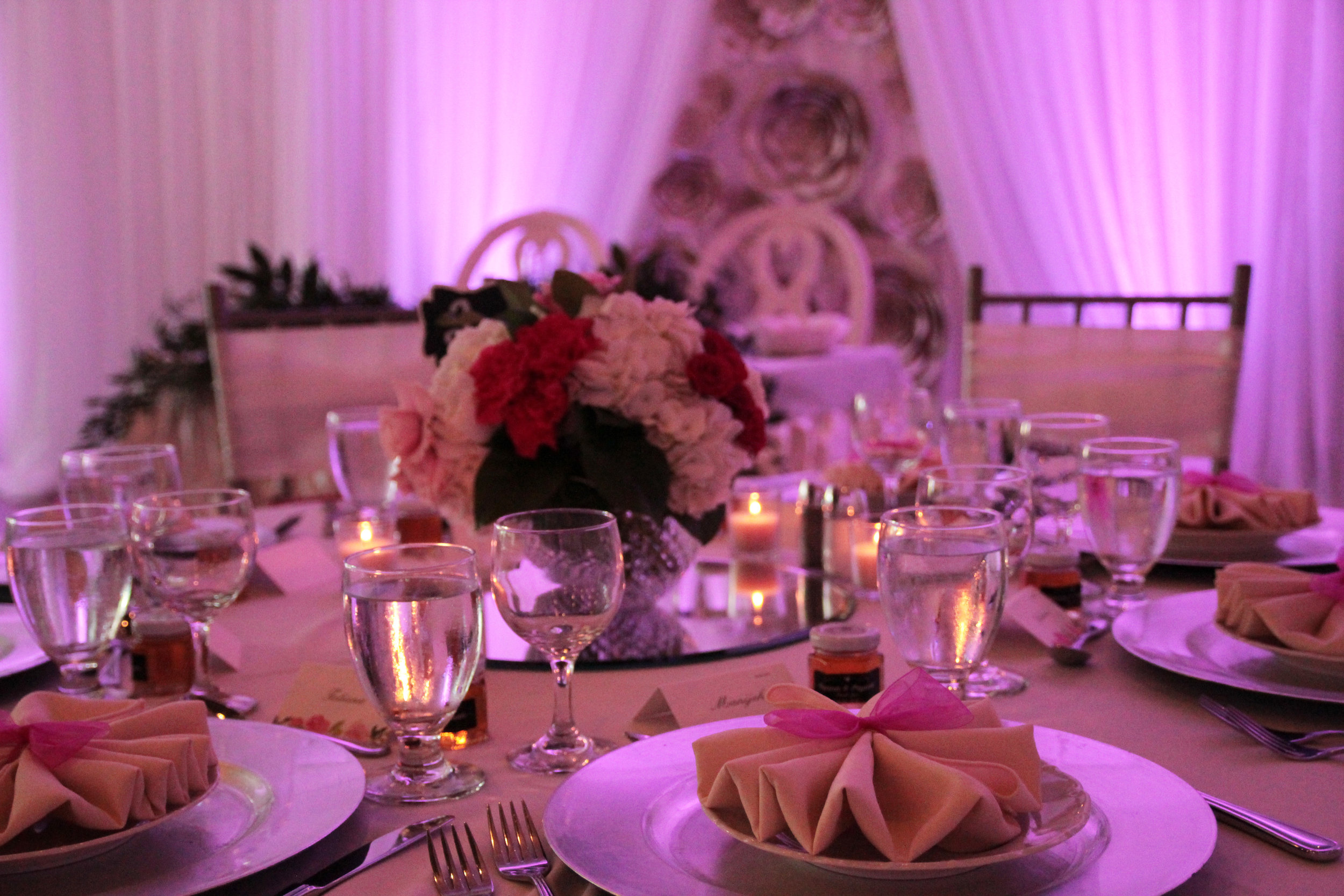 St. Marys Ballroom    wedding dramatically-decorated with layers of fabrics, flowers and lighting in fuchsia. Decor:    Devine Wedding Design   .