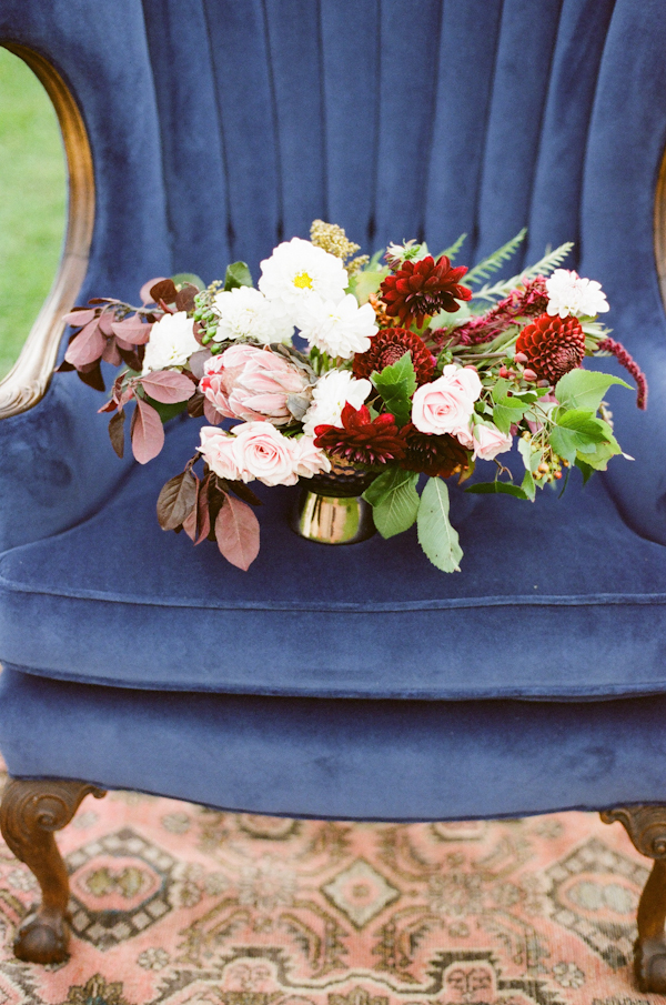 Bold cranberry red florals beautifully compliment blush tones, greenery, and navy accents. Photography: Kate Romenesko. Design: Kate Weinstein of Le Bash. Photo Source:    Wedding Chicks