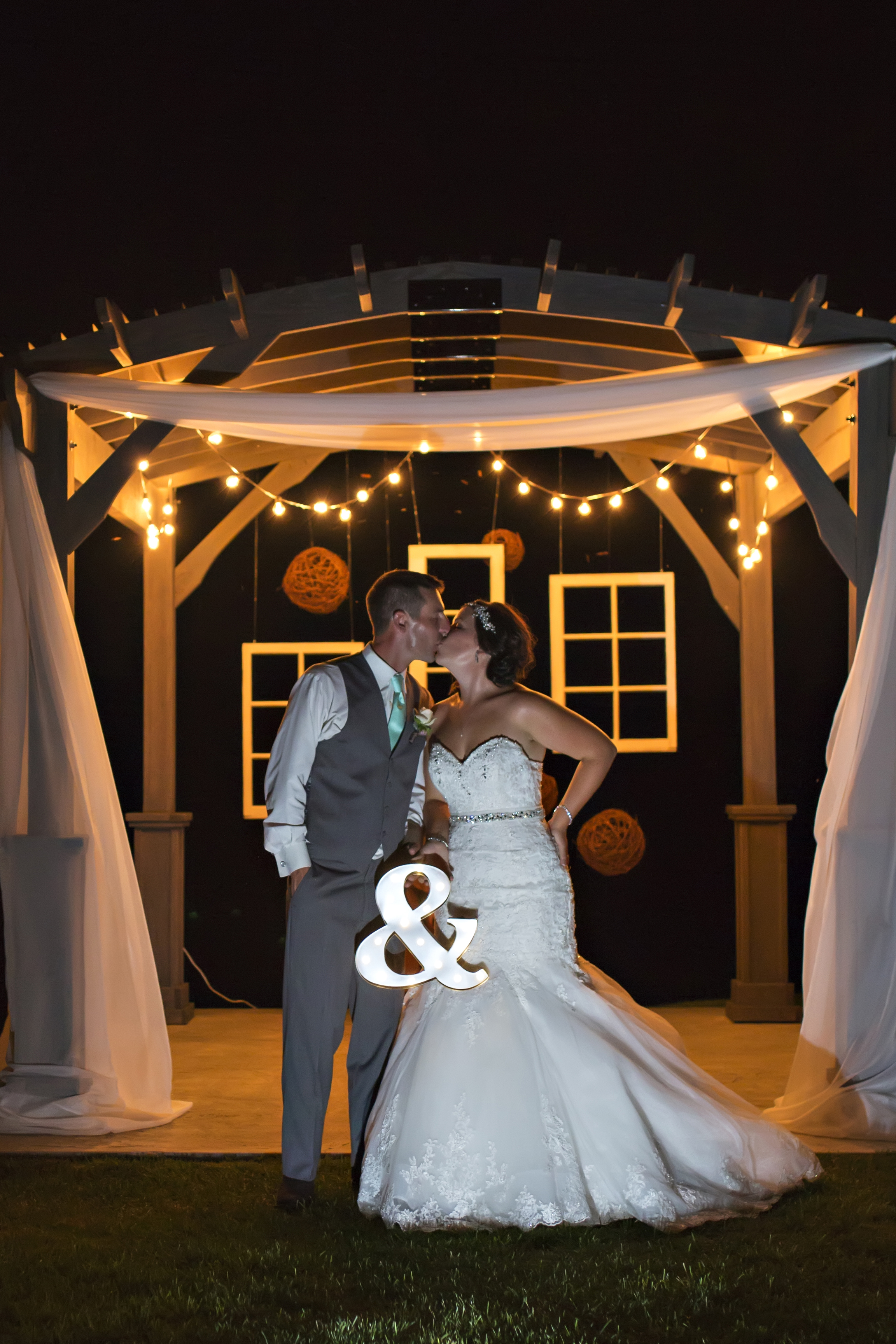 bride-groom-pergola-night-marquee-lights.jpg