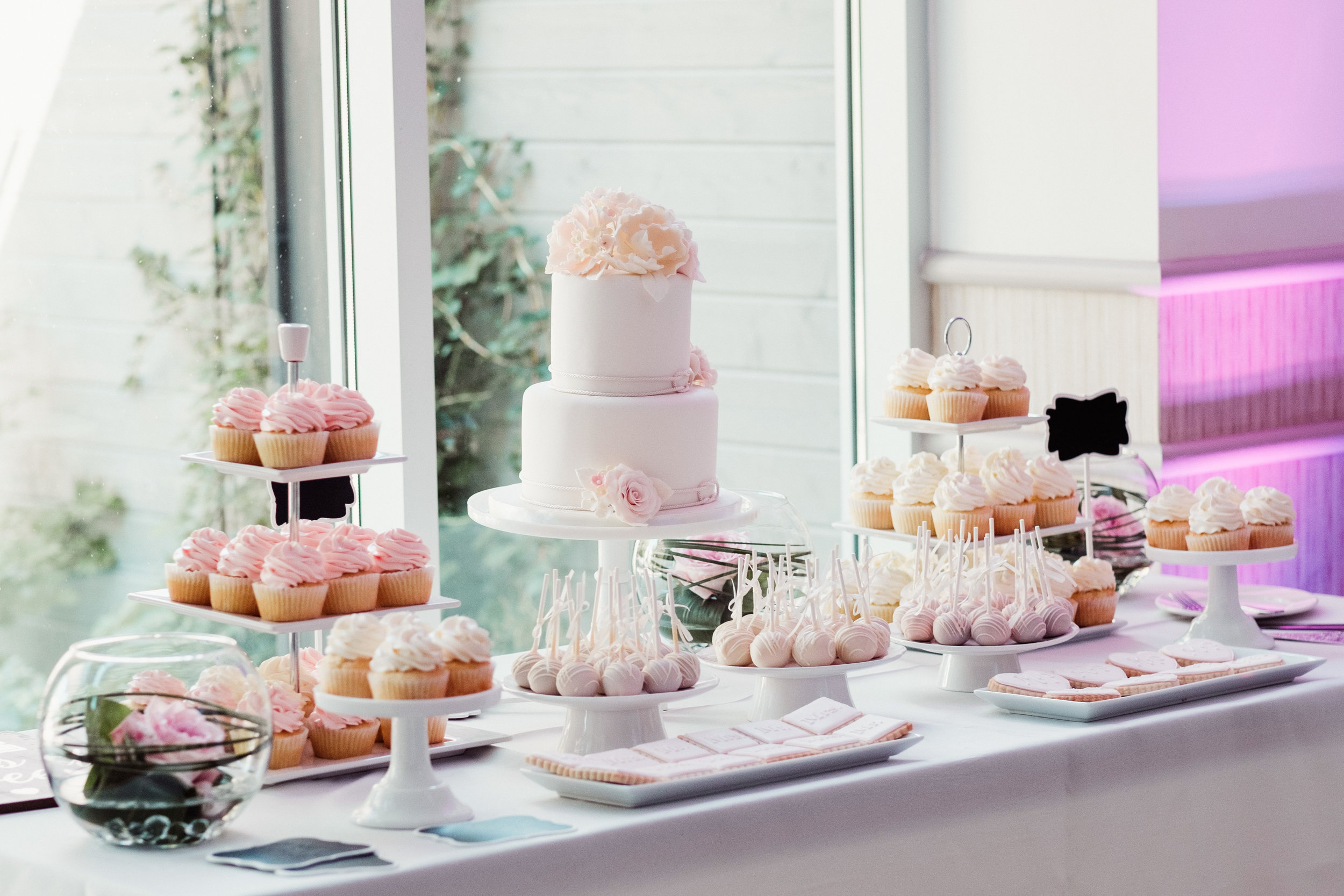 Colour-coordinated wedding cake and sweets table, designed by  The Cake Box . Venue:  St. Marys Golf & Country Club . Photography:  Bassem .