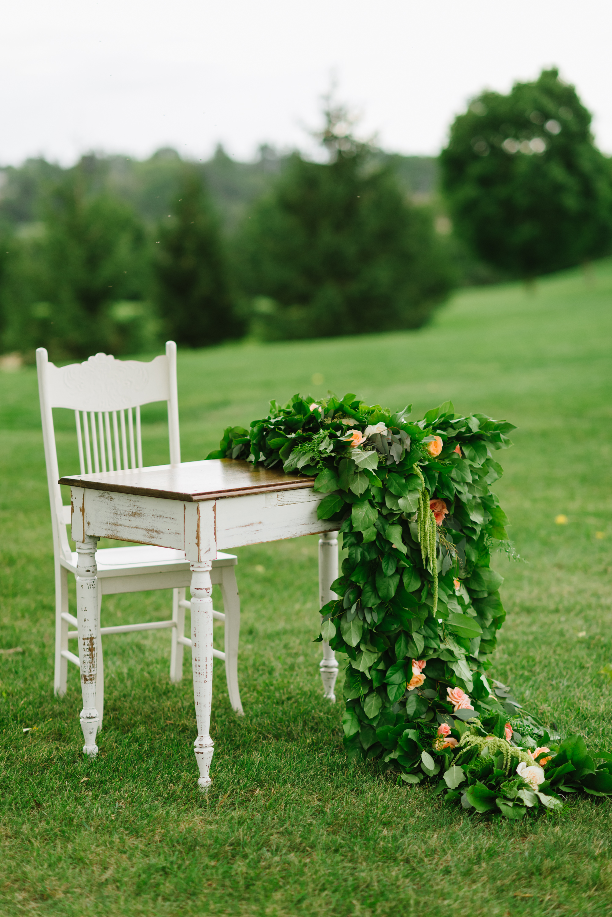 antique-signing-table-greenery-garland