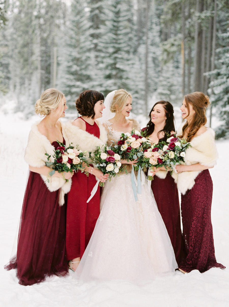 Chic faux fur stoles are the perfect winter wedding accessory for brides and their bridesmaids. Photo Source:  Style Me Pretty .