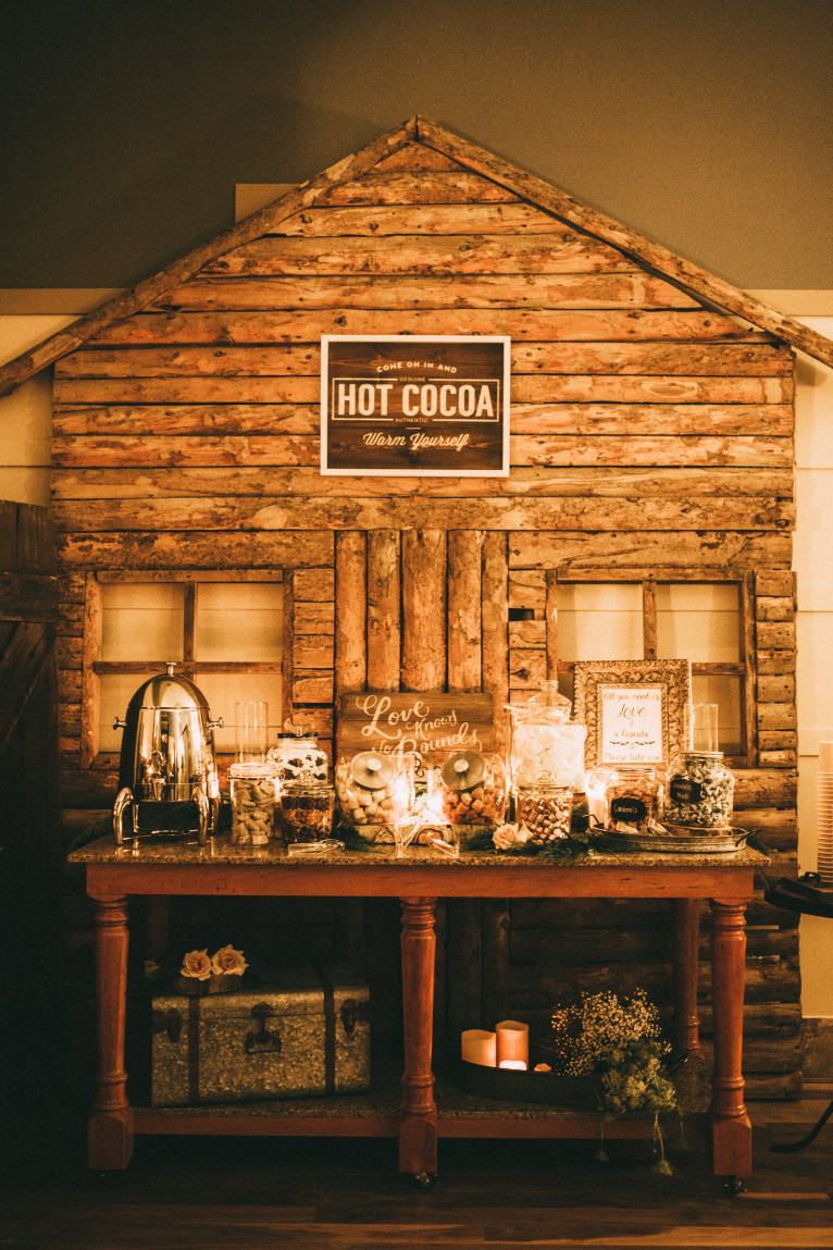 Keep guests of your winter wedding warm by offering a rustic-inspired hot cocoa bar, complete with all your favourite treats and fixings.   Photo Source:  India Earl Photography .