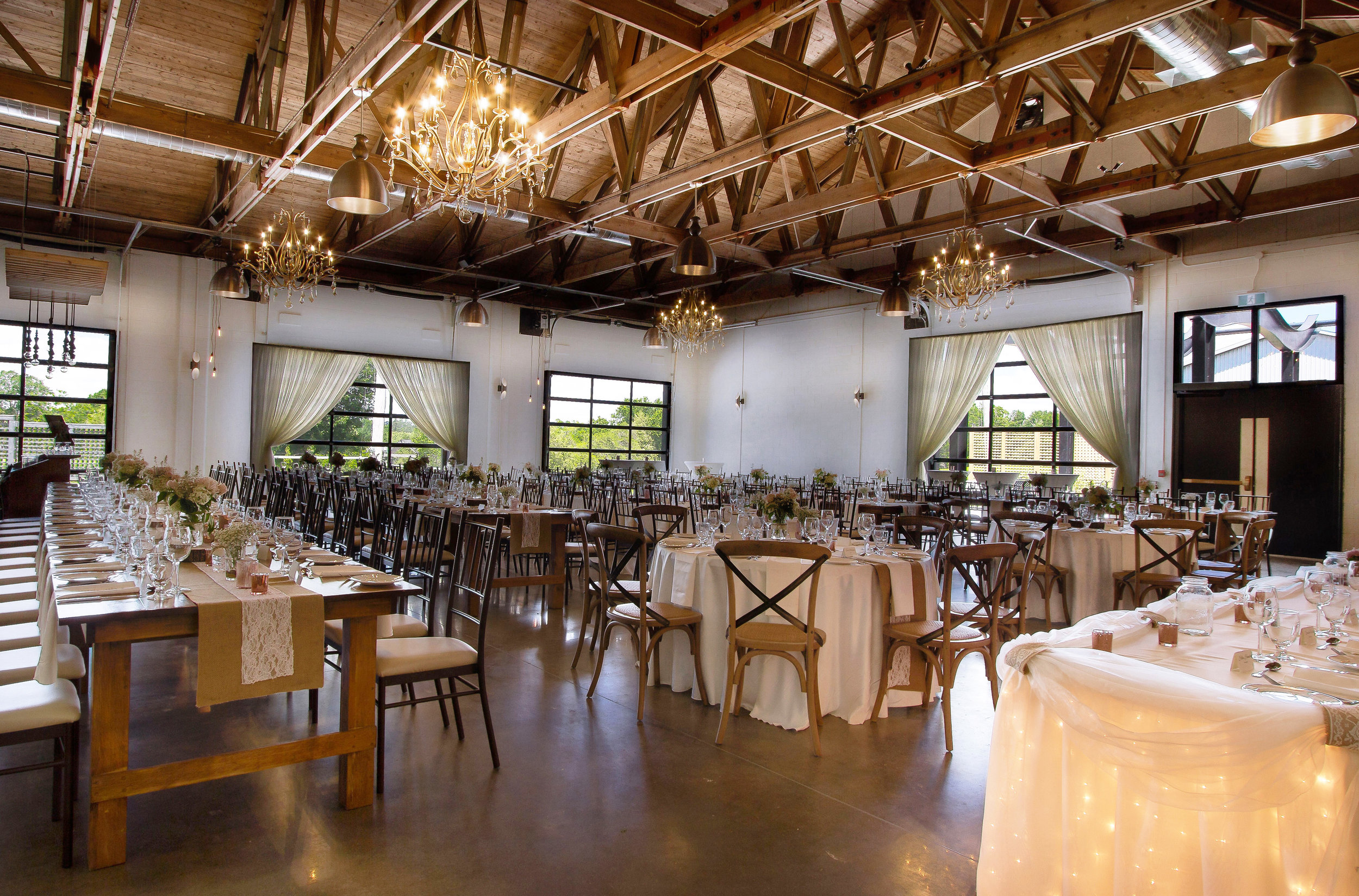The Hideaway    at St. Marys Golf & Country Club introduces a true rustic wedding venue in Ontario, with exposed wood beam ceilings, large glass garage doors, and polished concrete floors. Decor & Styling:    Above & Beyond Event Design   . Photography: David Jordan.