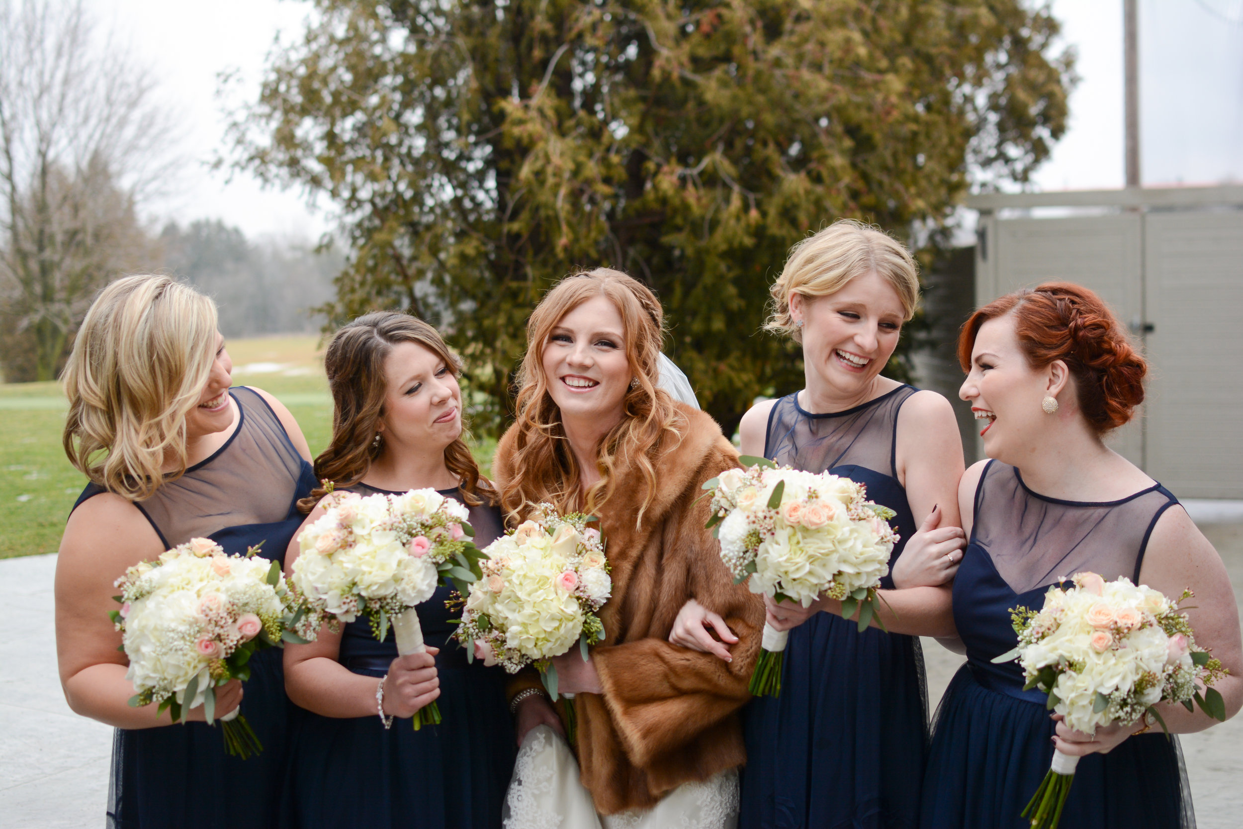 winter-wedding-bridesmaids-navy-dresses-furstole.jpg