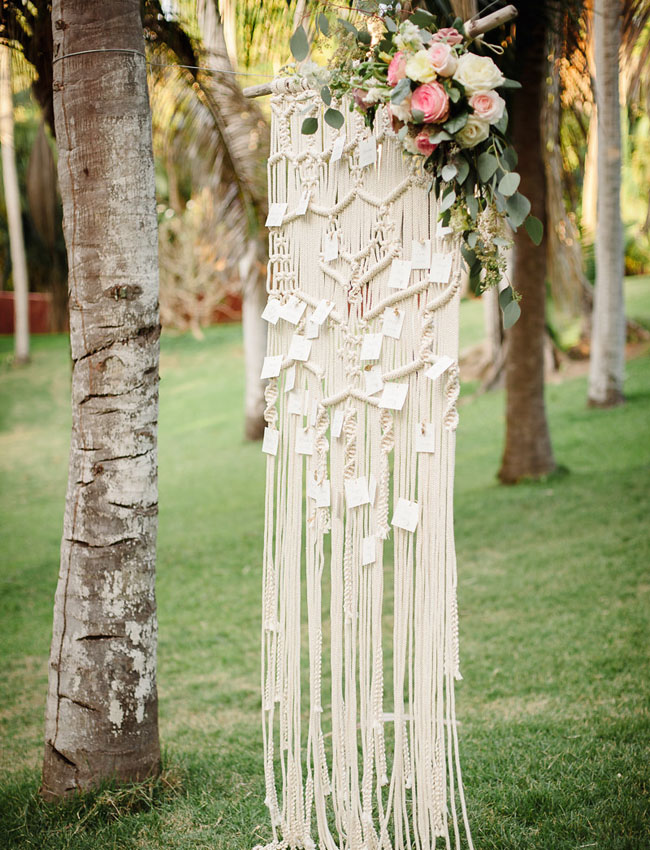 Macramé is a unique way to    display seating charts or escort cards, and it instantly adds a bohemian feel to an outdoor wedding. Photo Source:  Green Wedding Shoes .