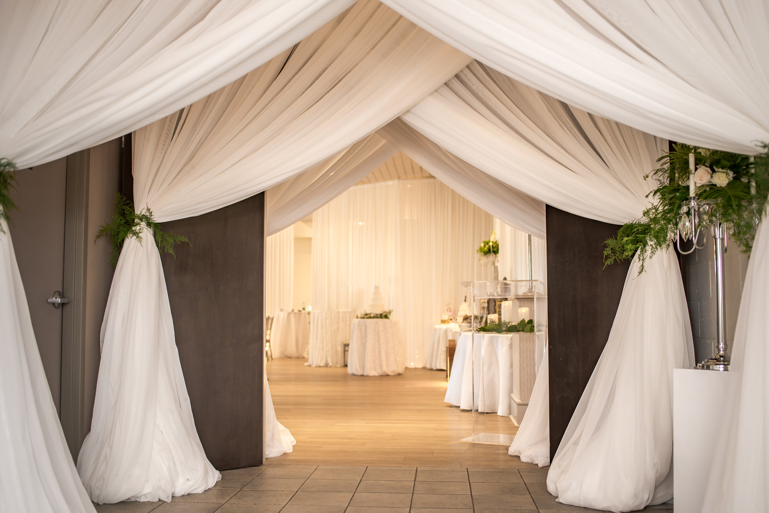 Guests of the Bridal Open House were welcomed into the show through the Ballroom entrance, which was draped in layers of romantic white sheers by Above & Beyond Event Design.