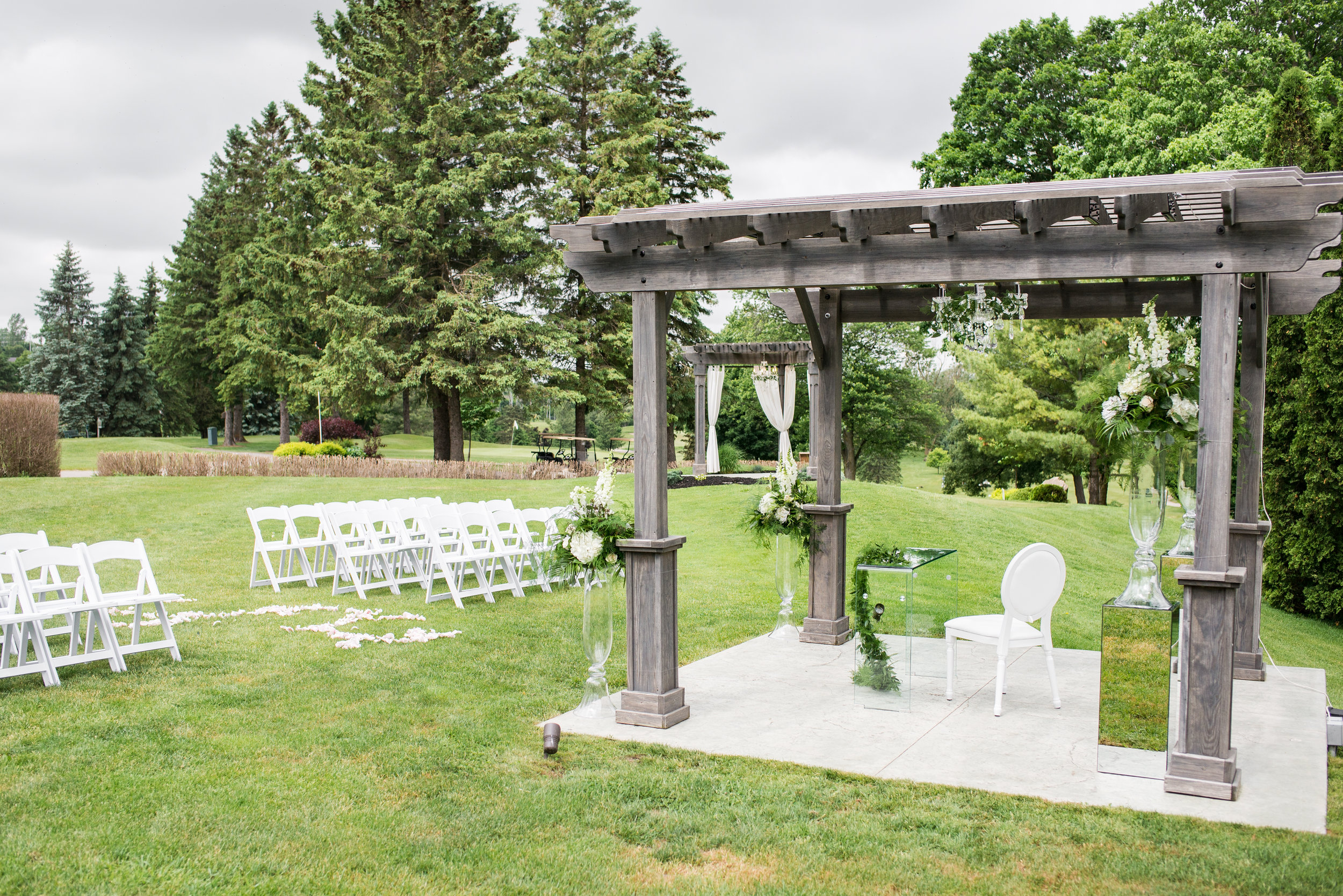 Both the ceremony and signing Ballroom pergolas were dressed with matching crystal chandeliers, courtesy of Above & Beyond Event Design.
