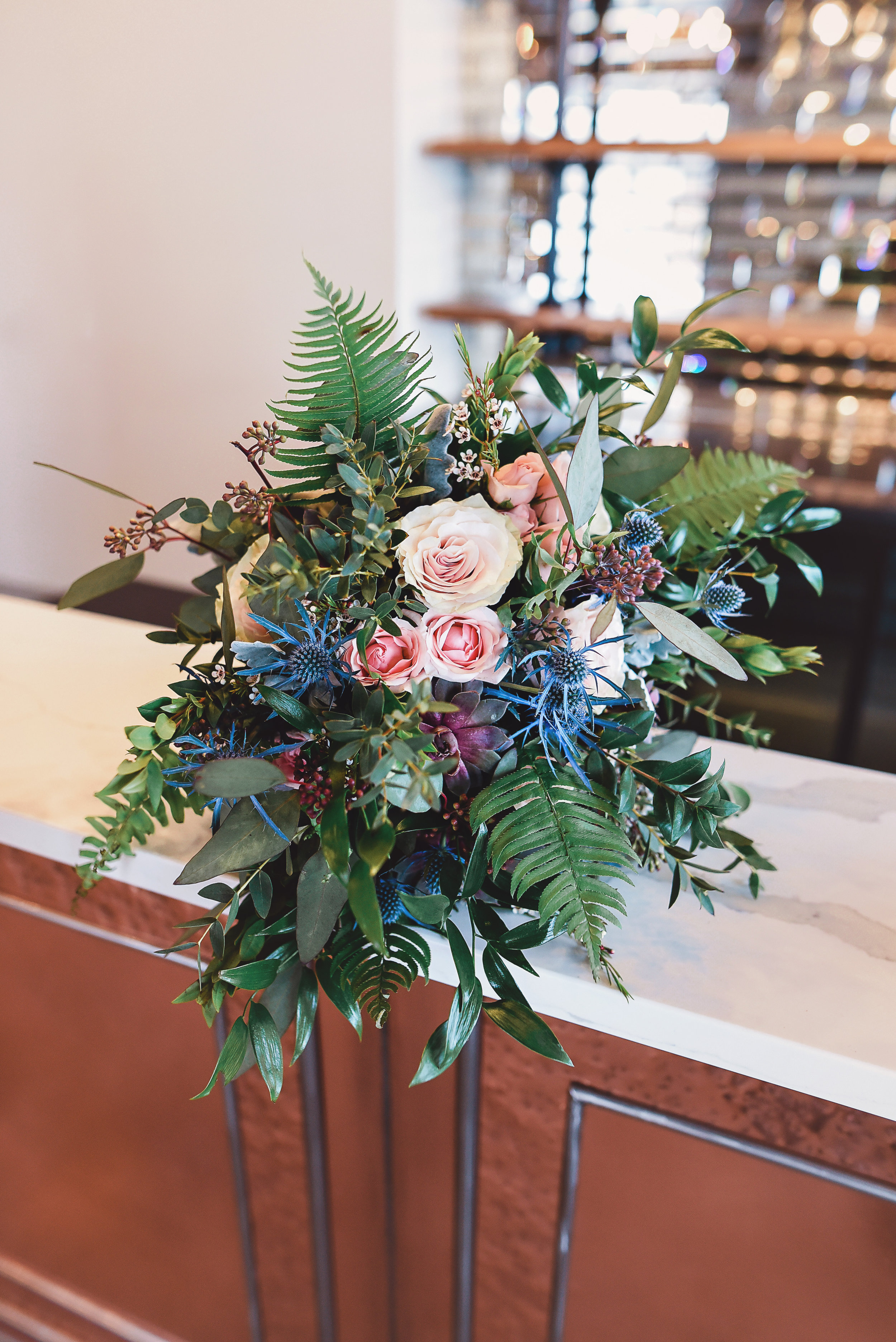 Moody florals, in deep tones such as purple and blue, and mixed with tropical varieties like palm and succulent, will be at the center of weddings this season. Venue:  The Hideaway  at St. Marys Golf & Country Club. Floral Design:  Lyric Flowers . Photography:  Angelic Images Photography .