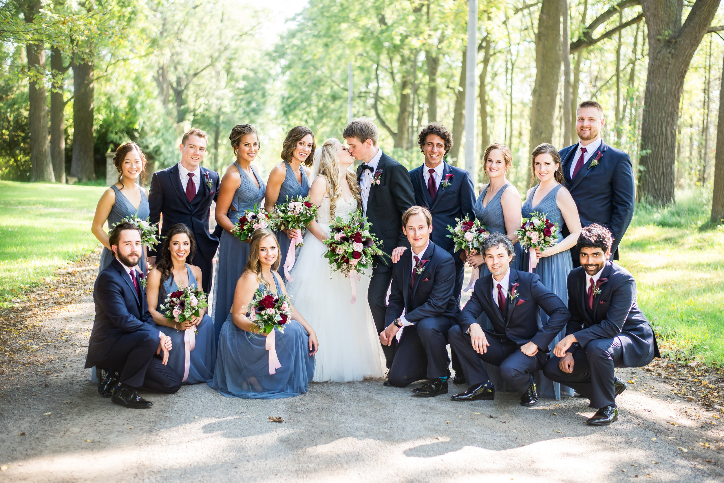 wedding_party_navy_suits_blue_bridesmaid_dresses