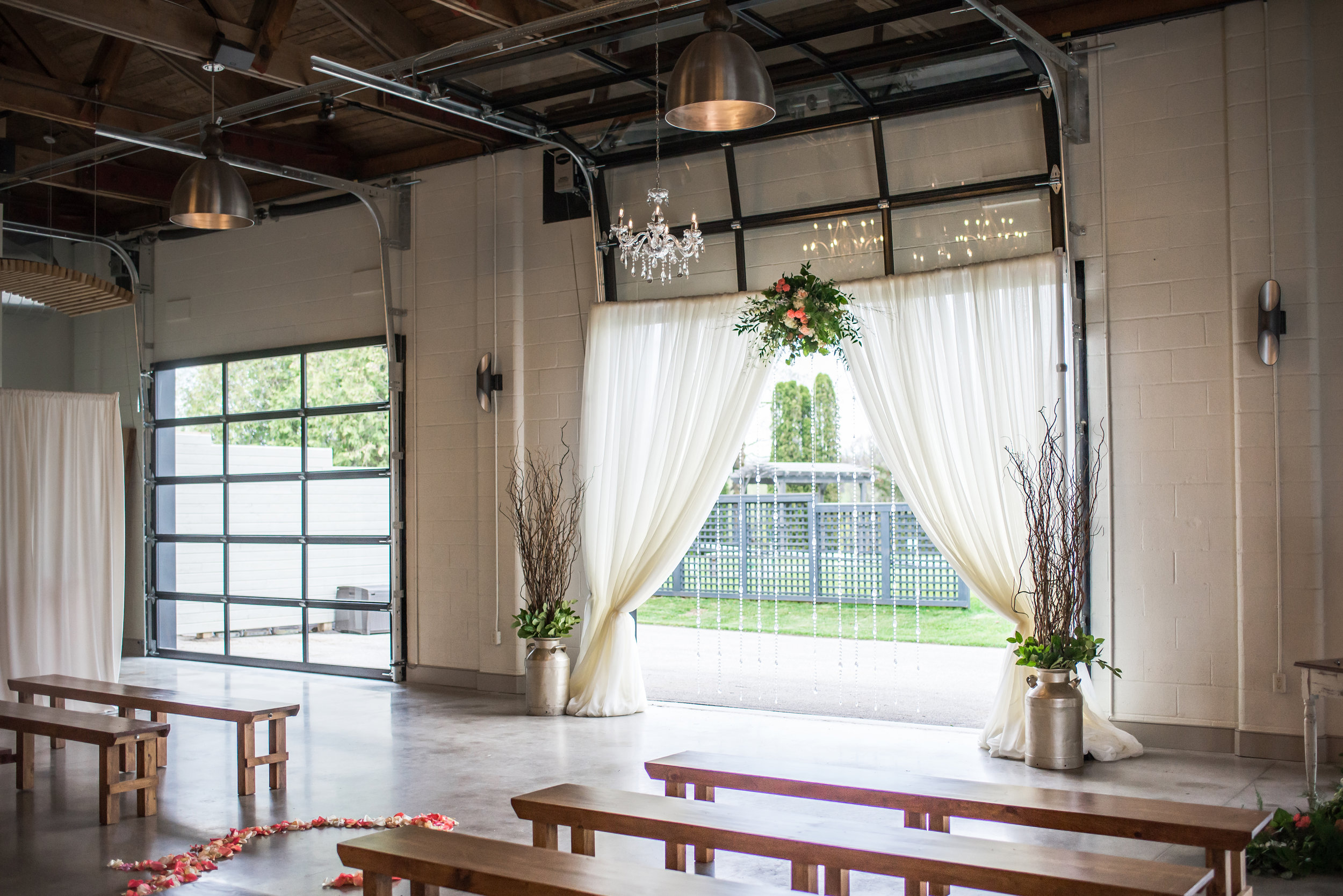 indoor_rustic_ceremony_draping_benches.jpg