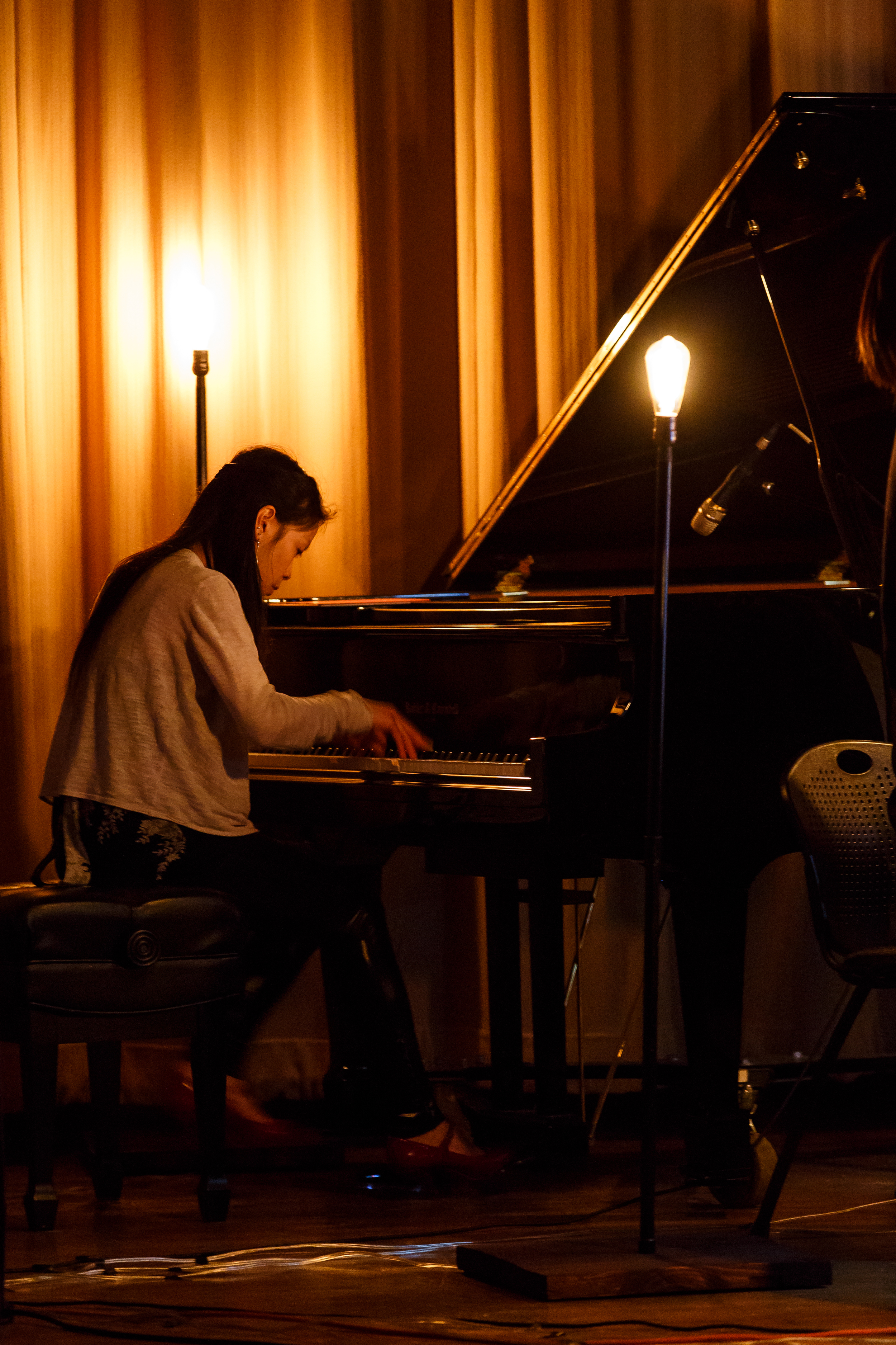 Our pianist Jeannette Fang performing with the lights.